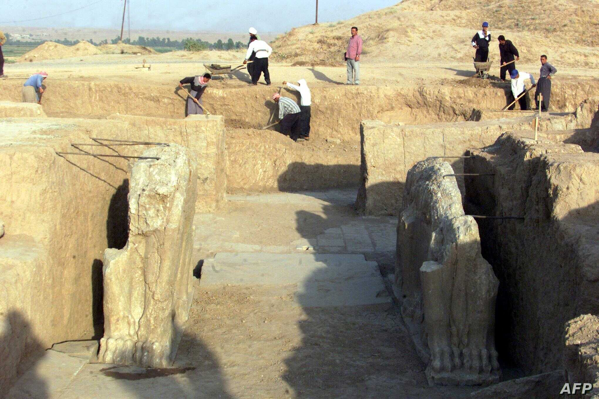 FILE - Iraqi workers in 2001 clean an archeological site in Nimrud. The Islamic State group has bulldozed the ancient Assyrian city, Iraq's government says, March 5, 2015.