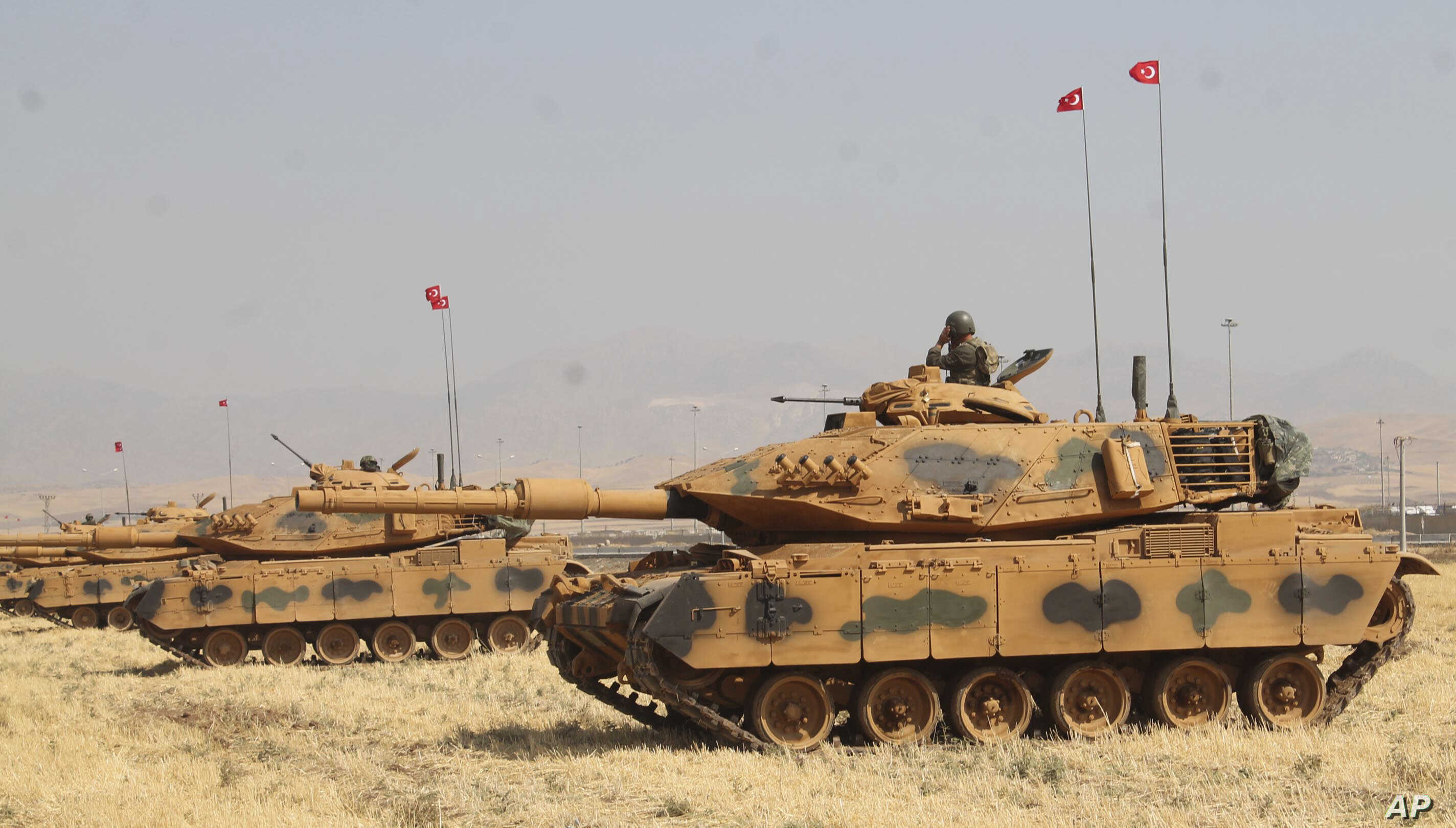 Turkey's Armed Forces officers in tanks take part in a military drill near the town of Silopi, Turkey, close to the Habur border gate between Turkey and the autonomous Kurdish region in Iraq, Sept. 18, 2017.
