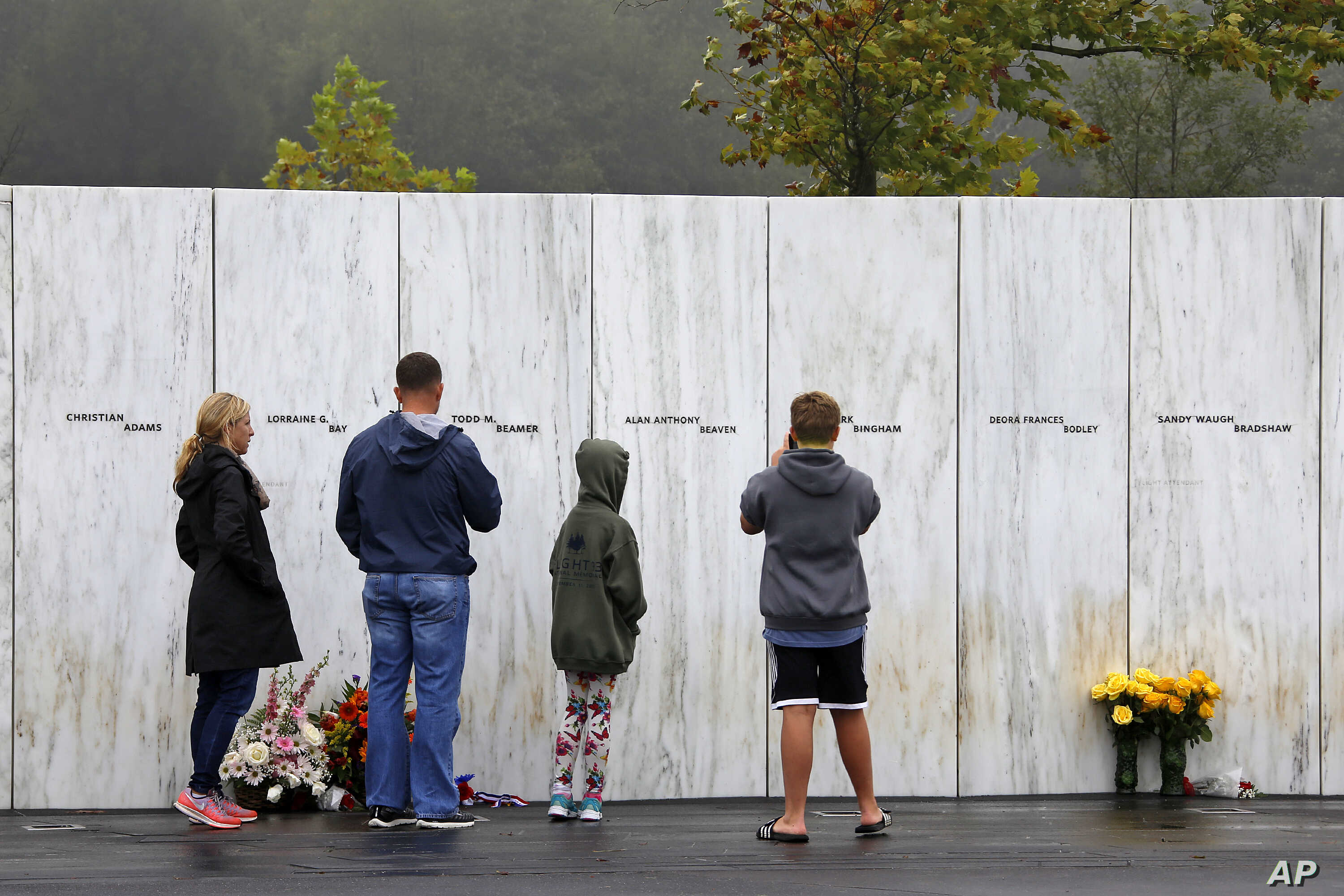 Visitors to the Flight 93 National Memorial in Shanksville, Pa., participate in a sunset memorial service on Monday, Sept. 10, 2018, as the nation marks the 17th anniversary of the Sept. 11, 2001 attacks.
