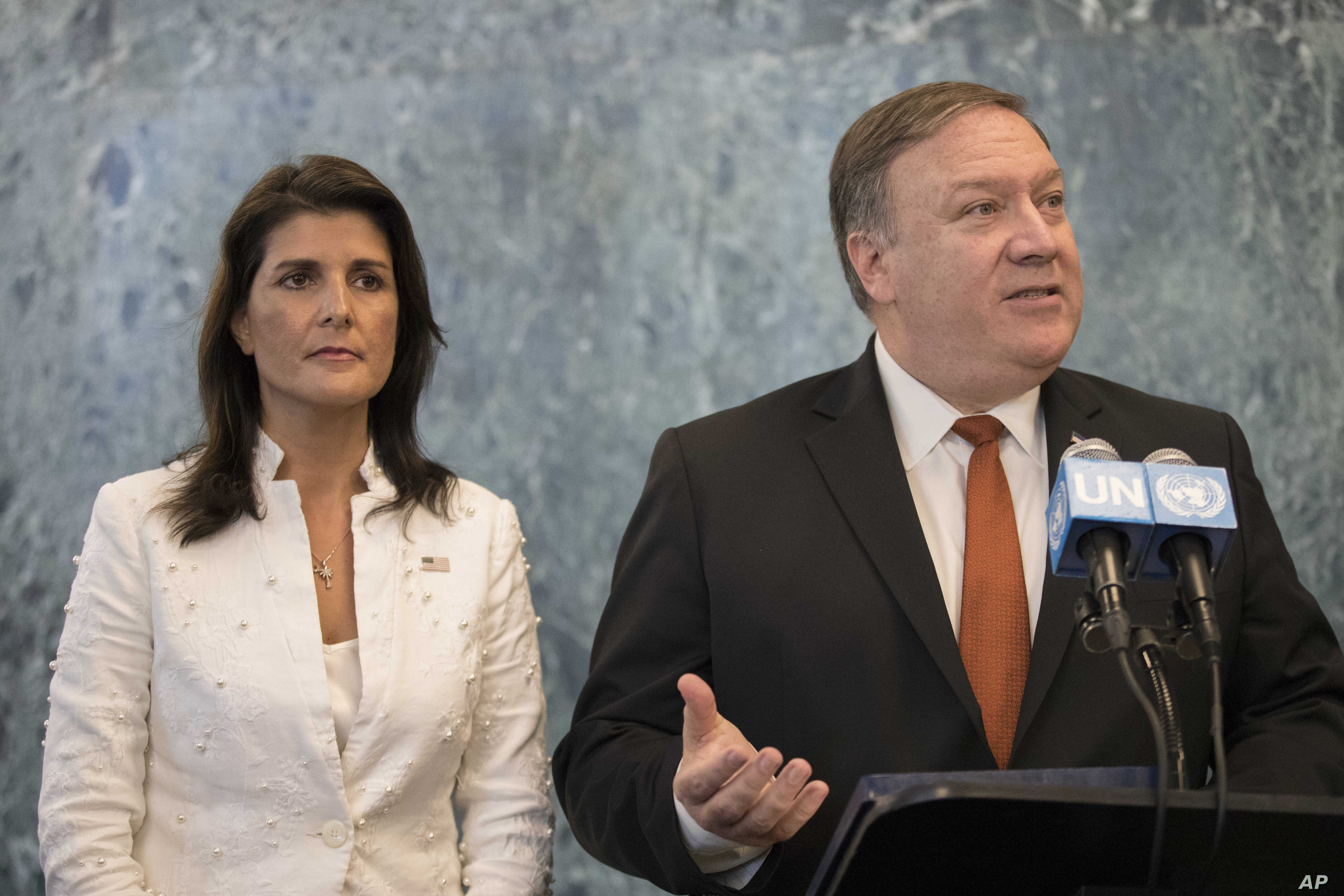 U. S. Secretary of State Mike Pompeo, with U.S. Ambassador to the United Nations Nikki Haley, speaks to reporters at U.N. headquarters, July 20, 2018.