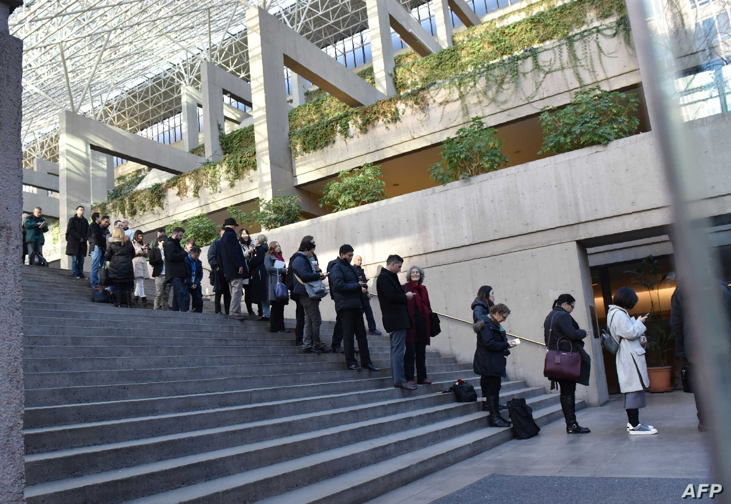 Media and members of the public line up outside the British Columbia Supreme Court to attend the trial of Meng Wanzhou, the chief financial officer of Huawei Technologies on Dec. 7, 2018 in Vancouver BC.