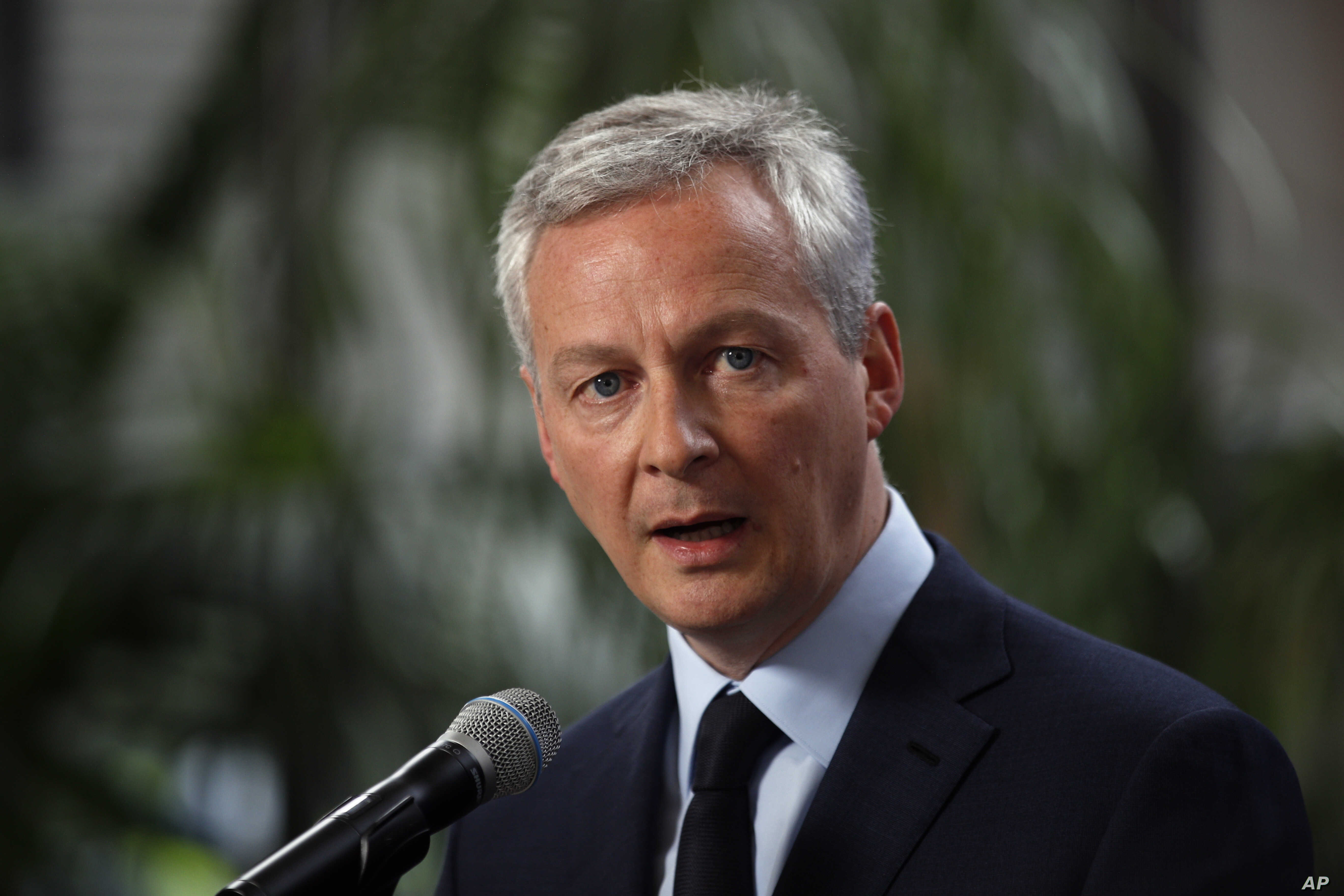 FILE - France's Finance Minister Bruno Le Maire delivers his statement at Bercy ministry, in Paris, May 15, 2018.