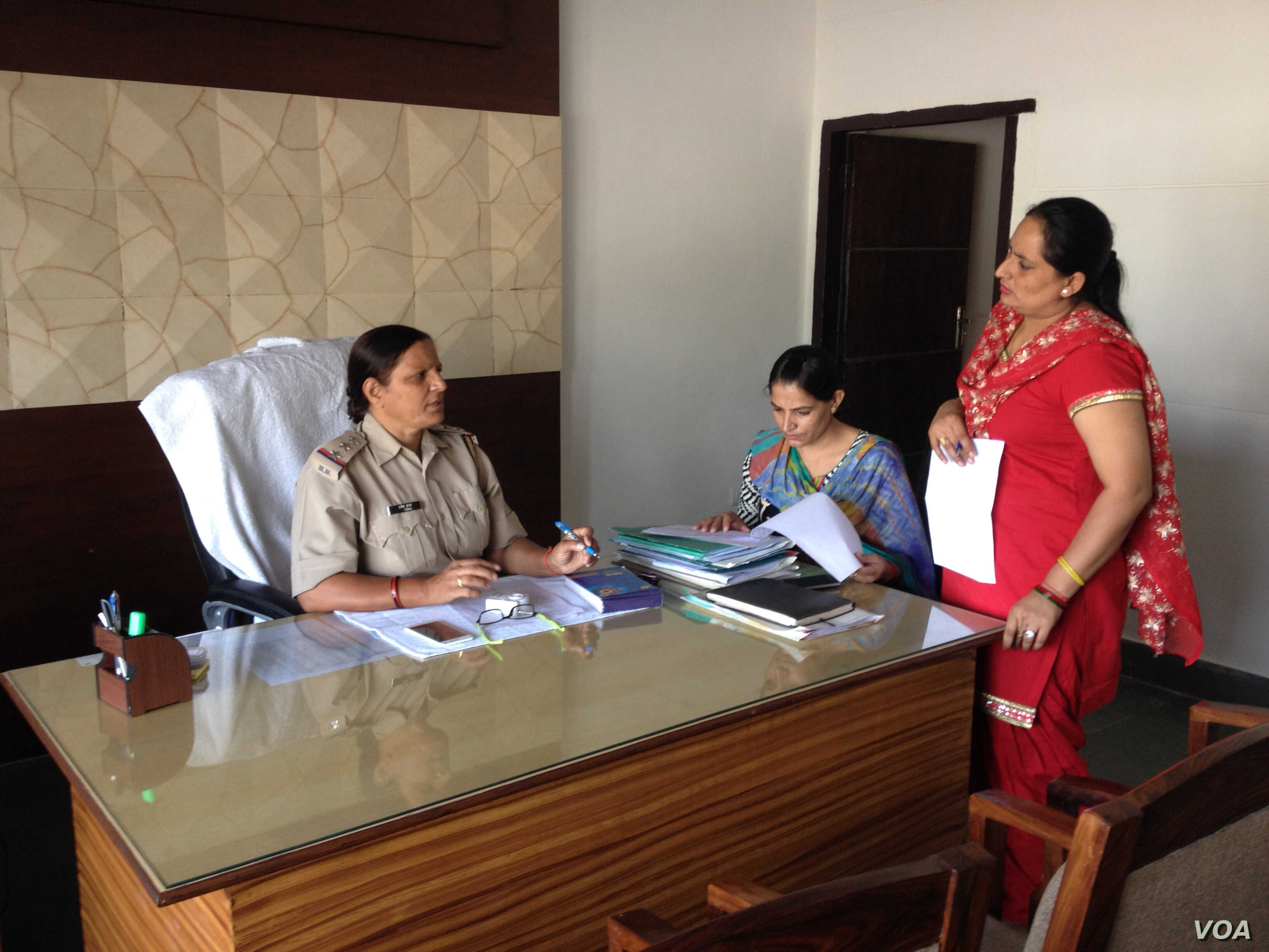 Inspector Umesh Bala gives instructions to her staff at the  Women Police Station in Gurgaon, Haryana