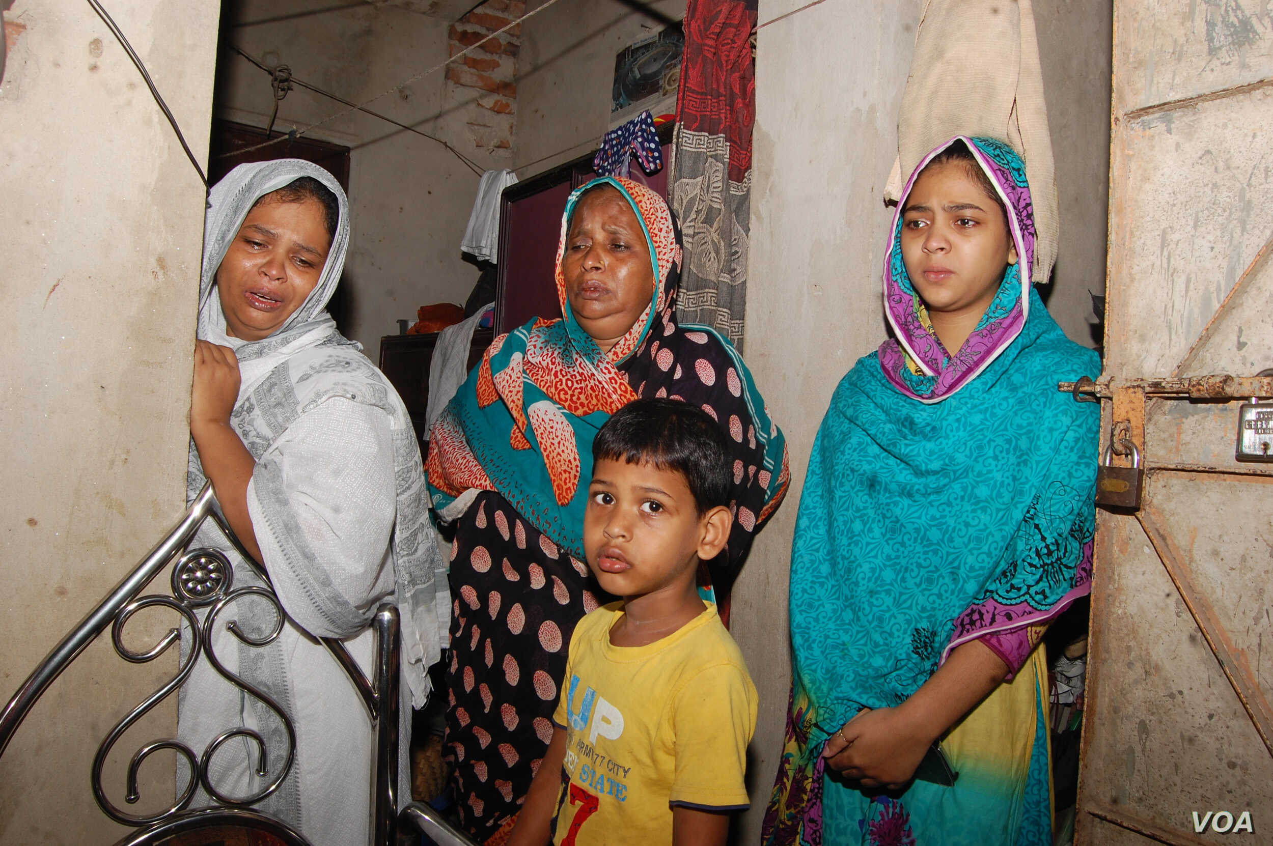 """Family members of Habibur Rahman, at their Chittagong home, a day after he was killed during the ongoing anti-drug campaign in Bangladesh. The young girl is Rahman's daughter Sanjida Rahman Eva and the boy is his son. """"My father was framed in drugs c..."""