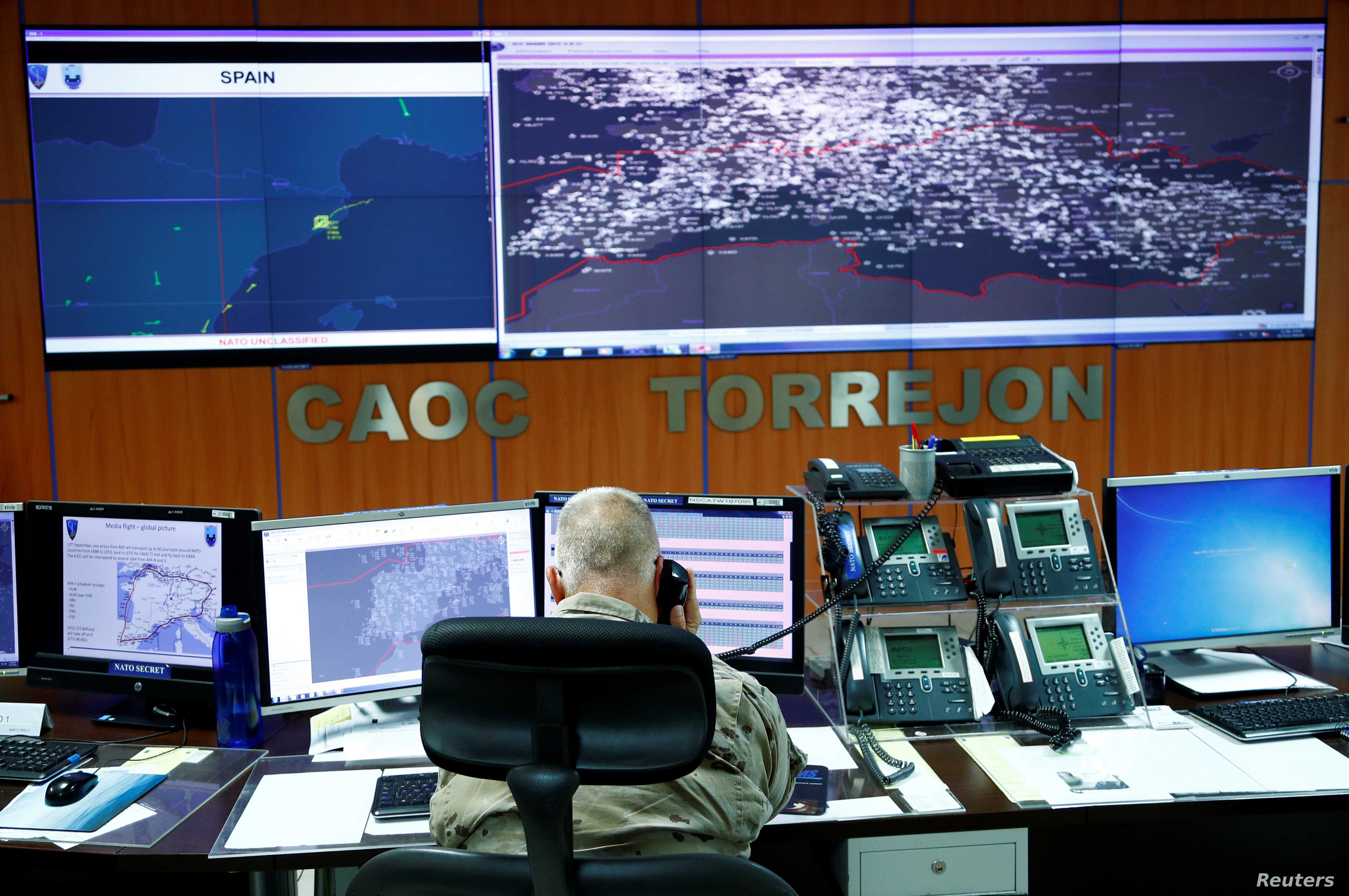 NATO personnel monitor air traffic at the Combined Air Operations Centre (CAOC) at Torrejon airbase, Spain, as part of NATO drills over Western Europe, Sept.12, 2018.