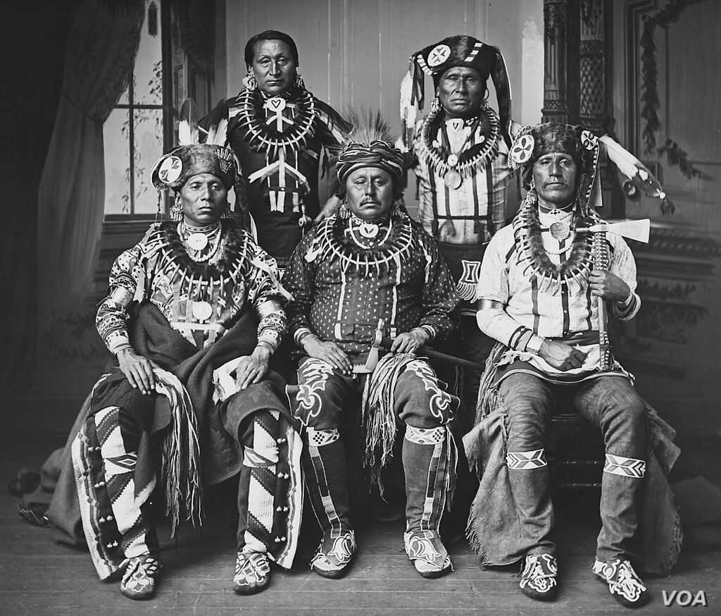 Photo of a delegation of Otoe tribe members wearing traditional claw necklaces and fur hats, during an official visit to Washington, D.C., in 1881.