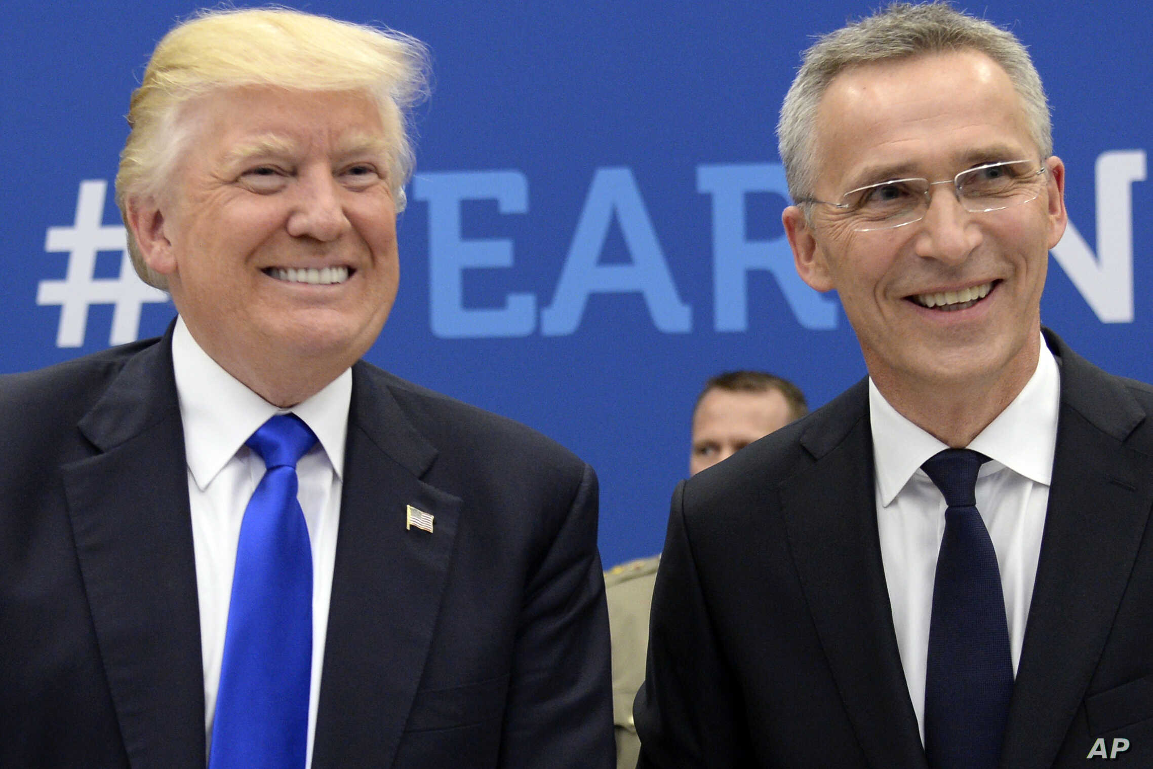 NATO Secretary General Jens Stoltenberg speaks with US President Donald Trump, left, during a summit at the NATO headquarters in Brussels, May 25, 2017.