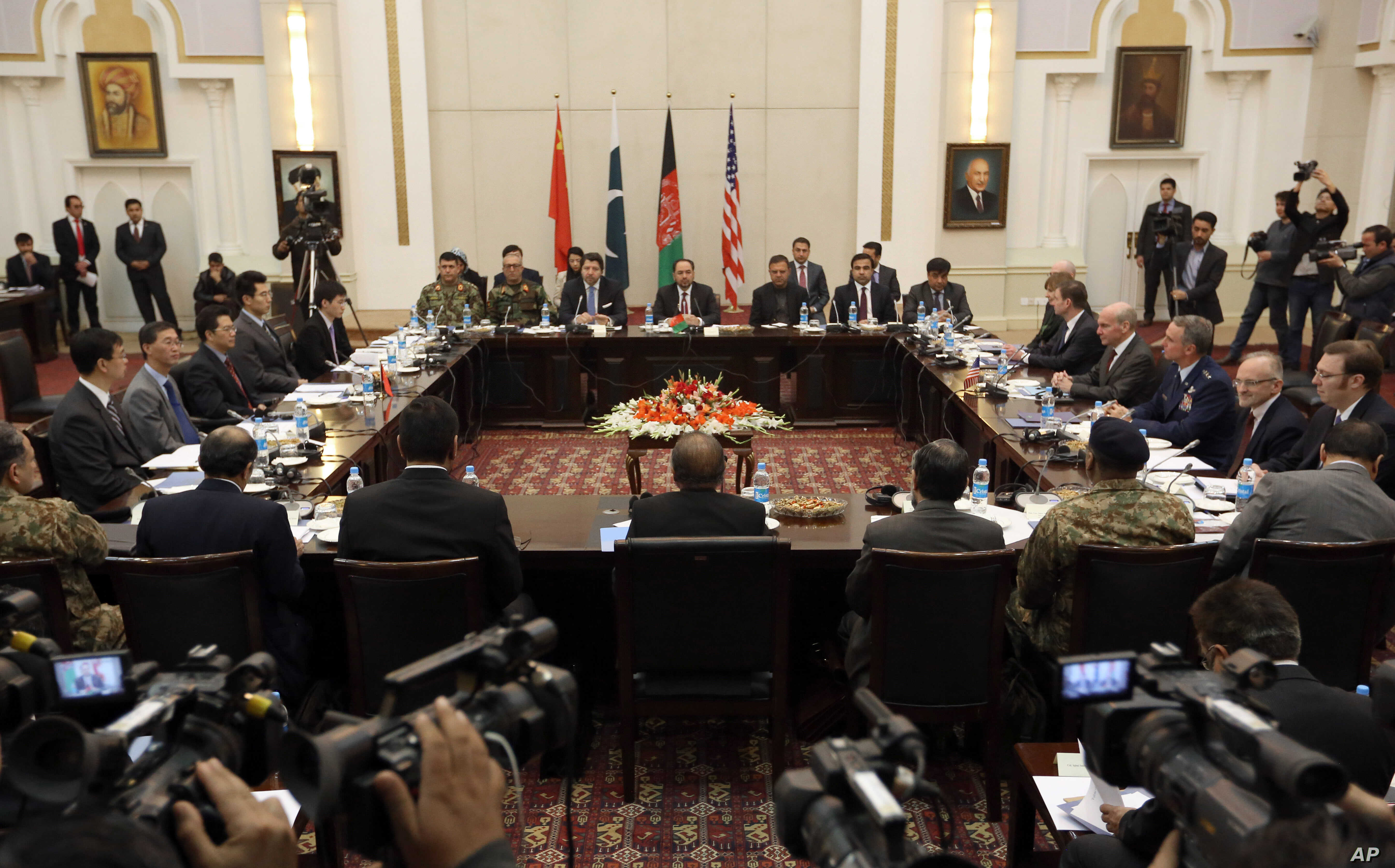 Delegations from Afghanistan, Pakistan, The United States of America and China discuss a road map for ending the war with the Taliban at the Presidential Palace in Kabul, Afghanistan, Monday, Jan. 18, 2016.