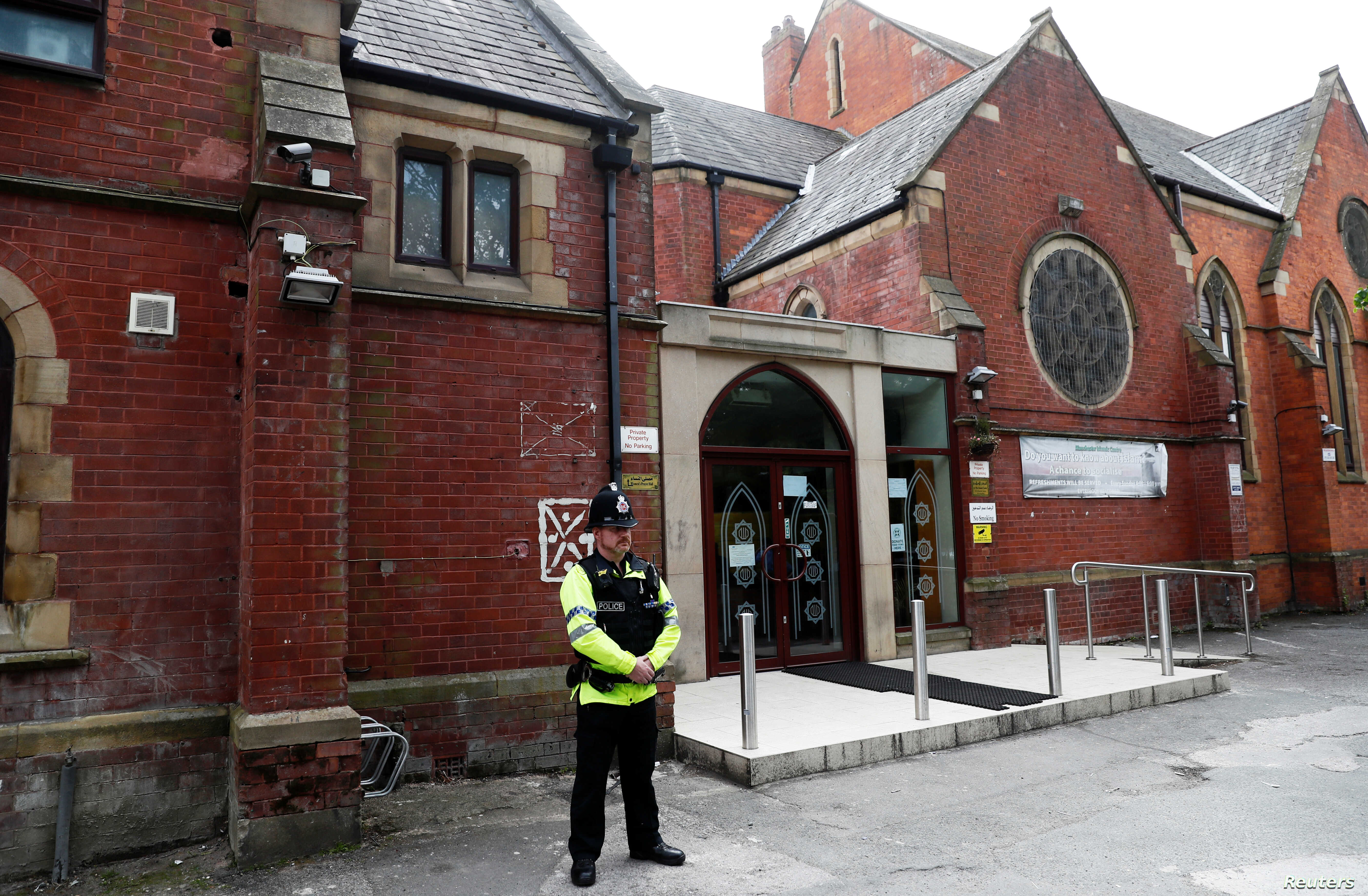 A police officer stands outside Didsbury mosque in Manchester, Britain, May 24, 2017.