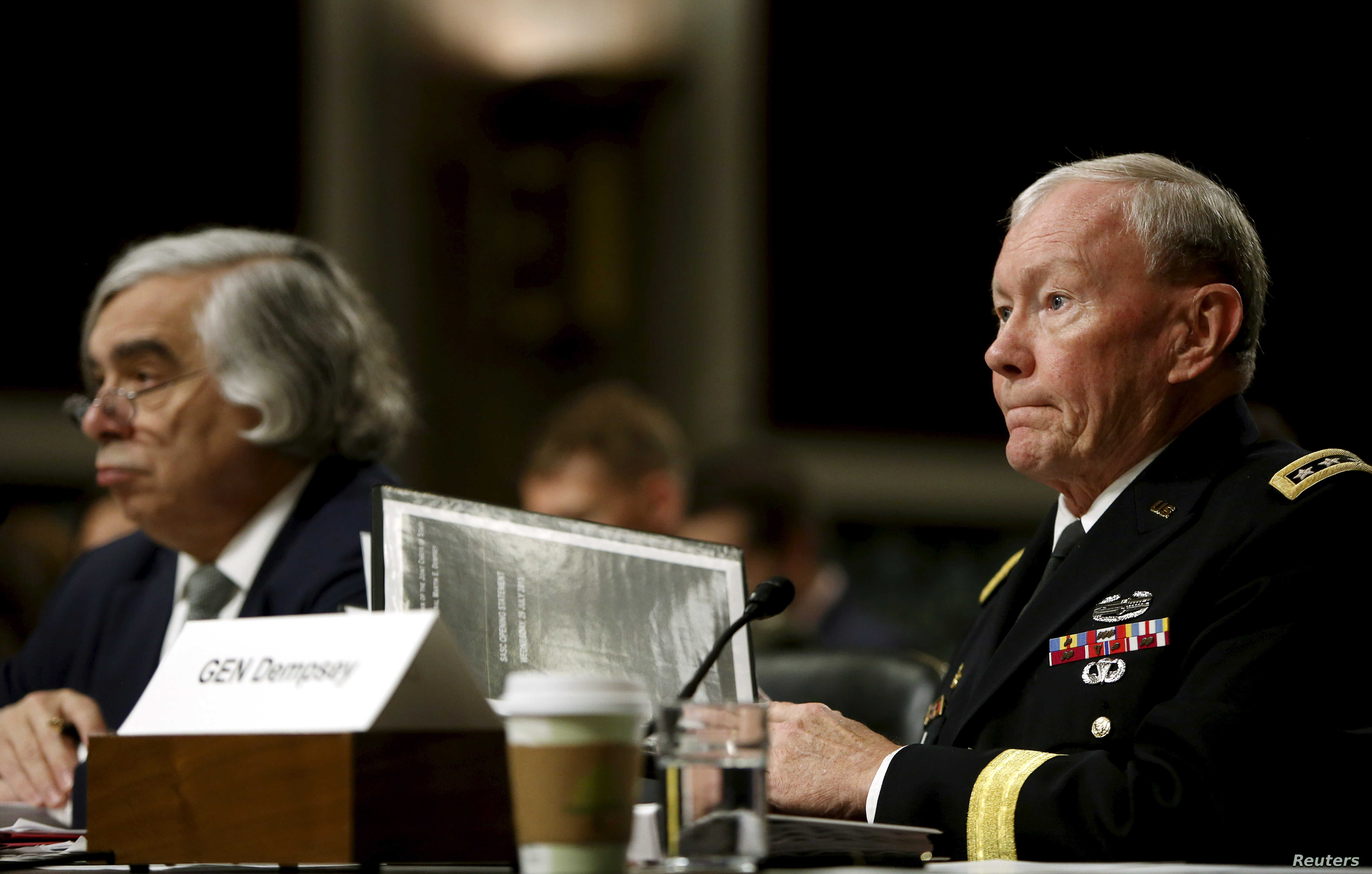 Chairman of the Joint Chiefs of Staff U.S. Army General Martin Dempsey, right, along with Energy Secretary Ernest Moniz, left, appear before the Senate Armed Services Committee in Washington, July 29, 2015.