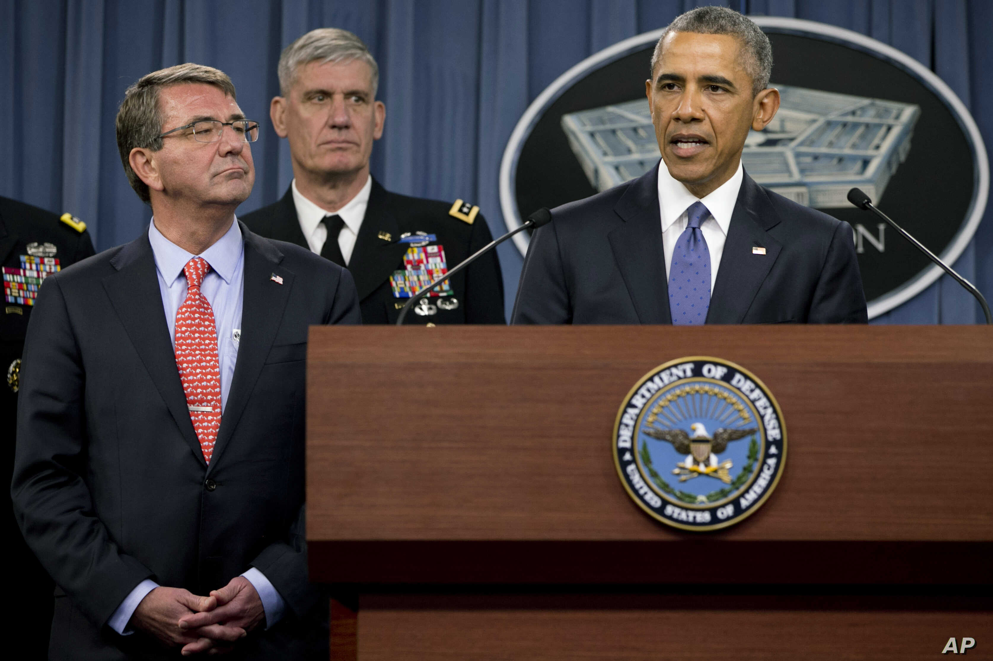 President Barack Obama, right, speaks to the media after receiving an update from military leaders on the campaign against the Islamic State, during a rare visit to the Pentagon, July 6, 2015. Defense Secretary Ash Carter is at left.