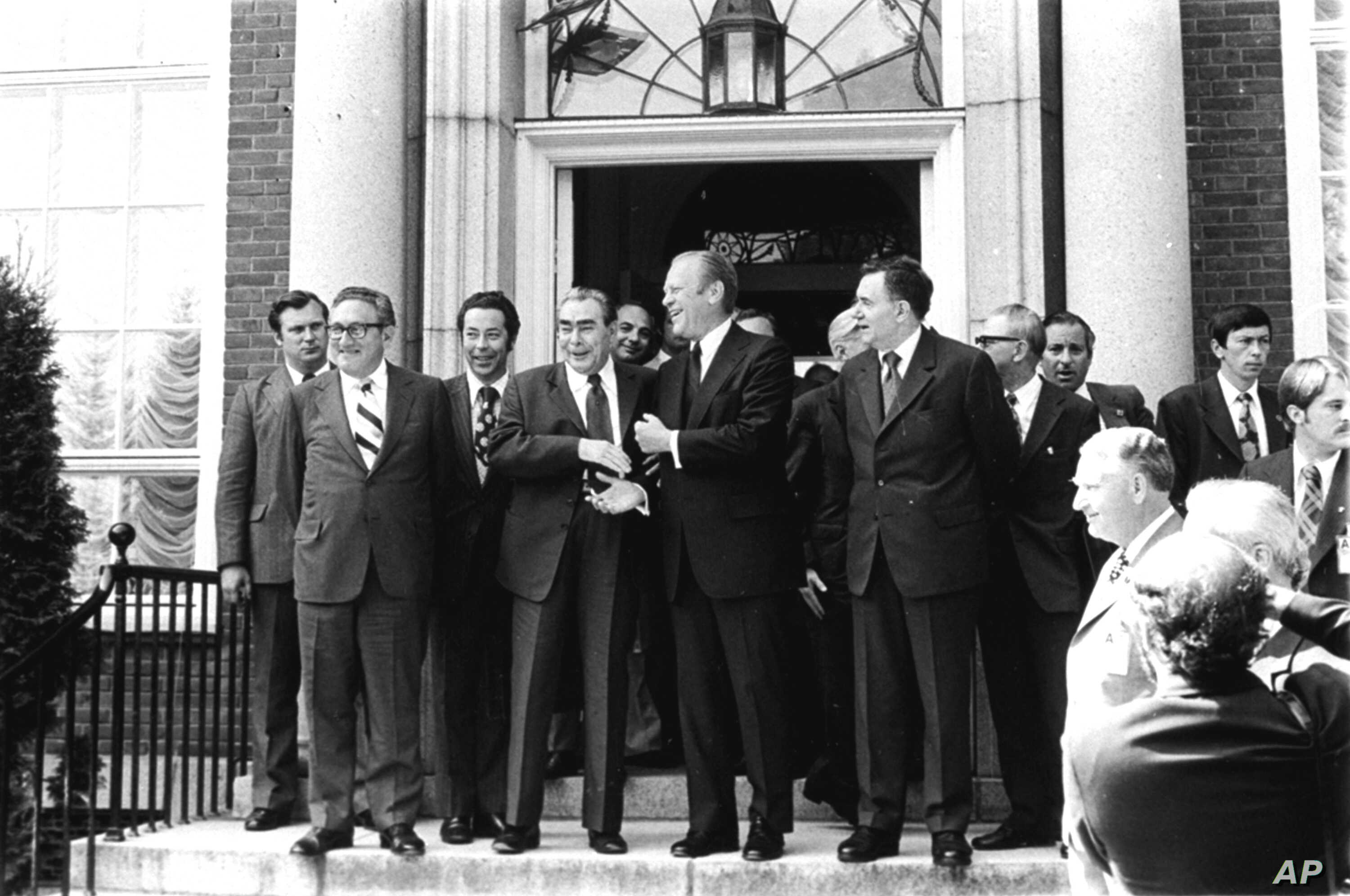 Soviet General Secretary Leonid Brezhnev shakes hands with President Ford after their first round of talks at the American Embassy in Helsinki, July 30, 1975.  (AP Photo)