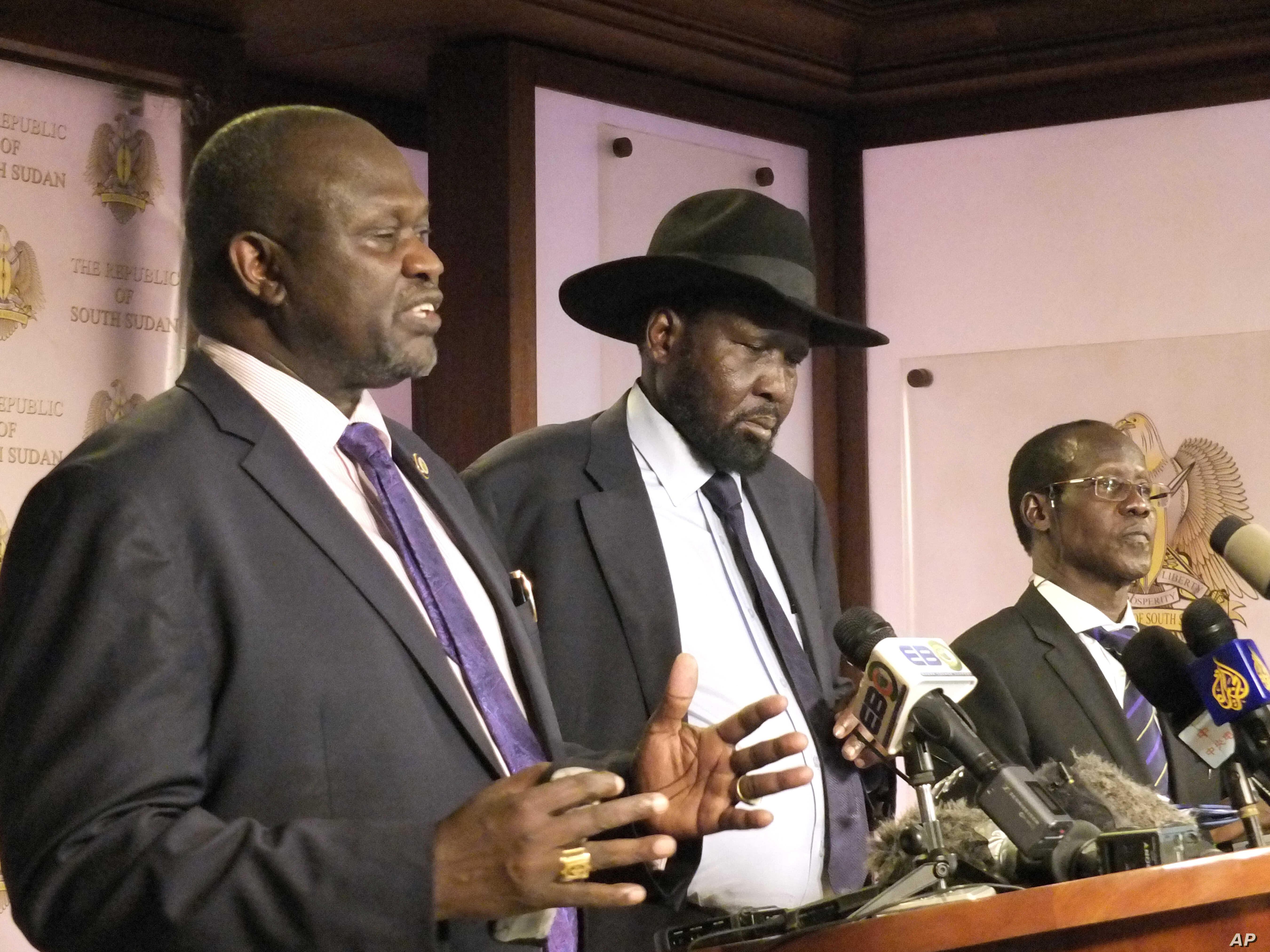 South Sudan Riek Machar, left. Salva Kiir, South Sudan President, and James Wani Igga, Vice president during a press conference at Presidential palace in Juba, South Sudan, July 8, 2016, after fighting started erupted when a group of unidentified sol...