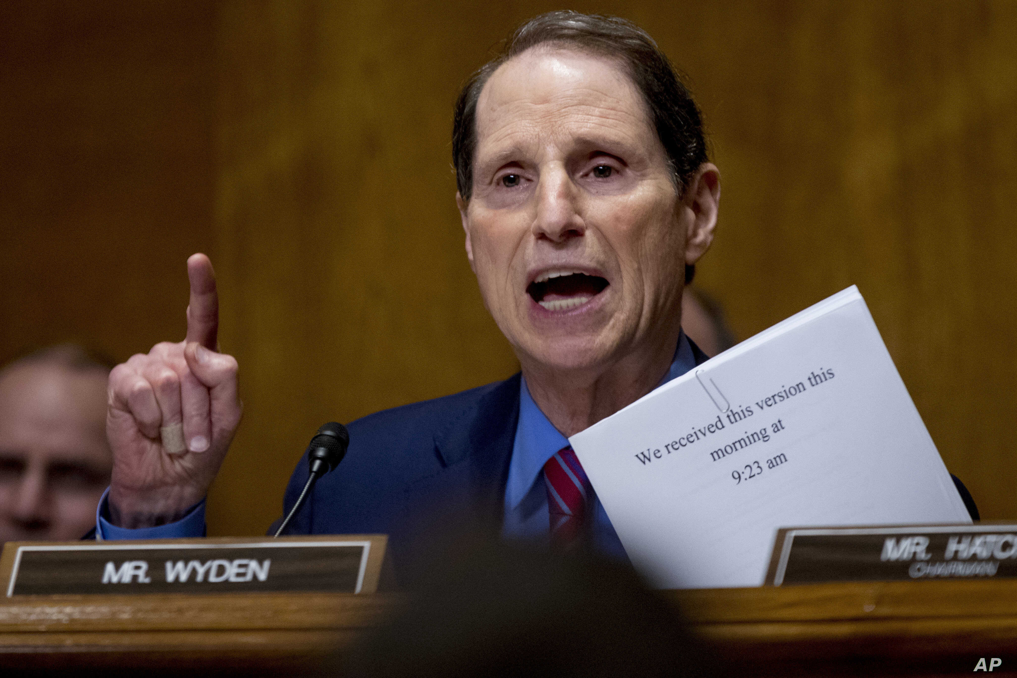 FILE - Sen. Ron Wyden, D-Oregon, speaks on Capitol Hill in Washington, Sept. 25, 2017. Wyden wants to know how well prepared the country's top voting machine manufacturers are against hackers.