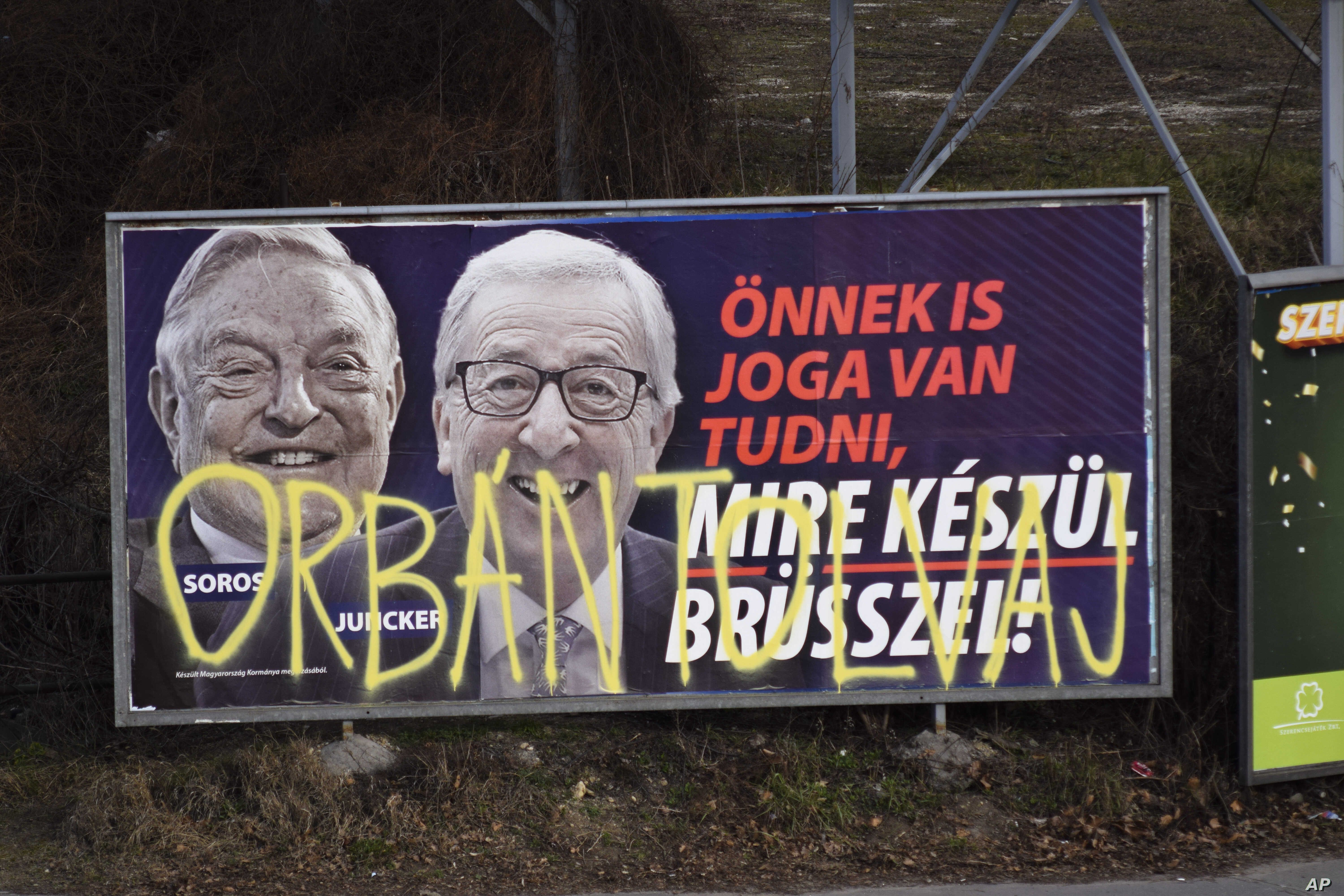 "A billboard from a campaign of the Hungarian government showing EU Commission President Jean-Claude Juncker and Hungarian-American financier George Soros with the caption ""You, too, have a right to know what Brussels is preparing to do"" is displayed ..."