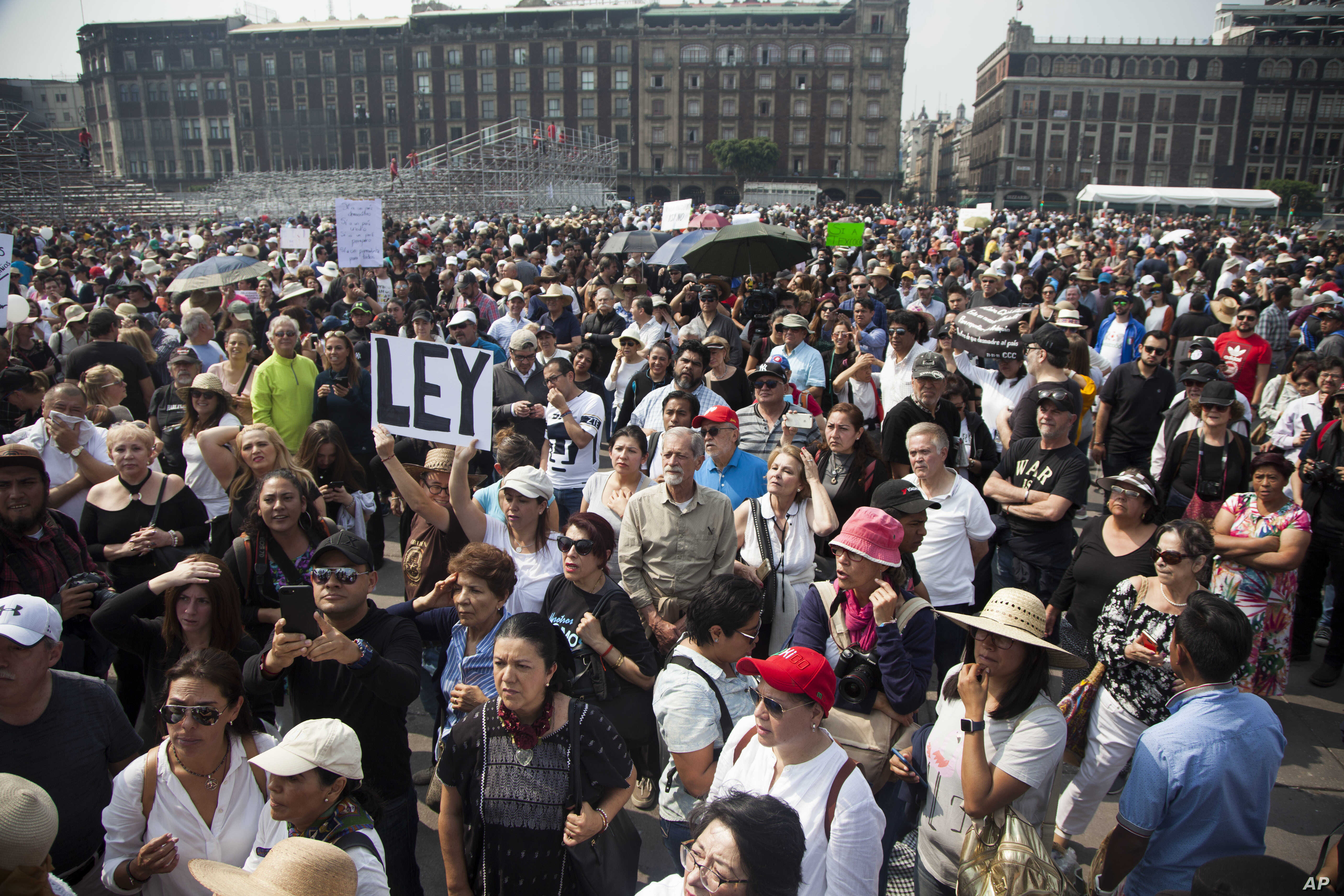 FILE - Thousands of people protest in Mexico City in opposition to President-elect Andres Manuel Lopez Obrador's plans to cancel a new $13 billion airport for the capital, Nov. 11, 2018.