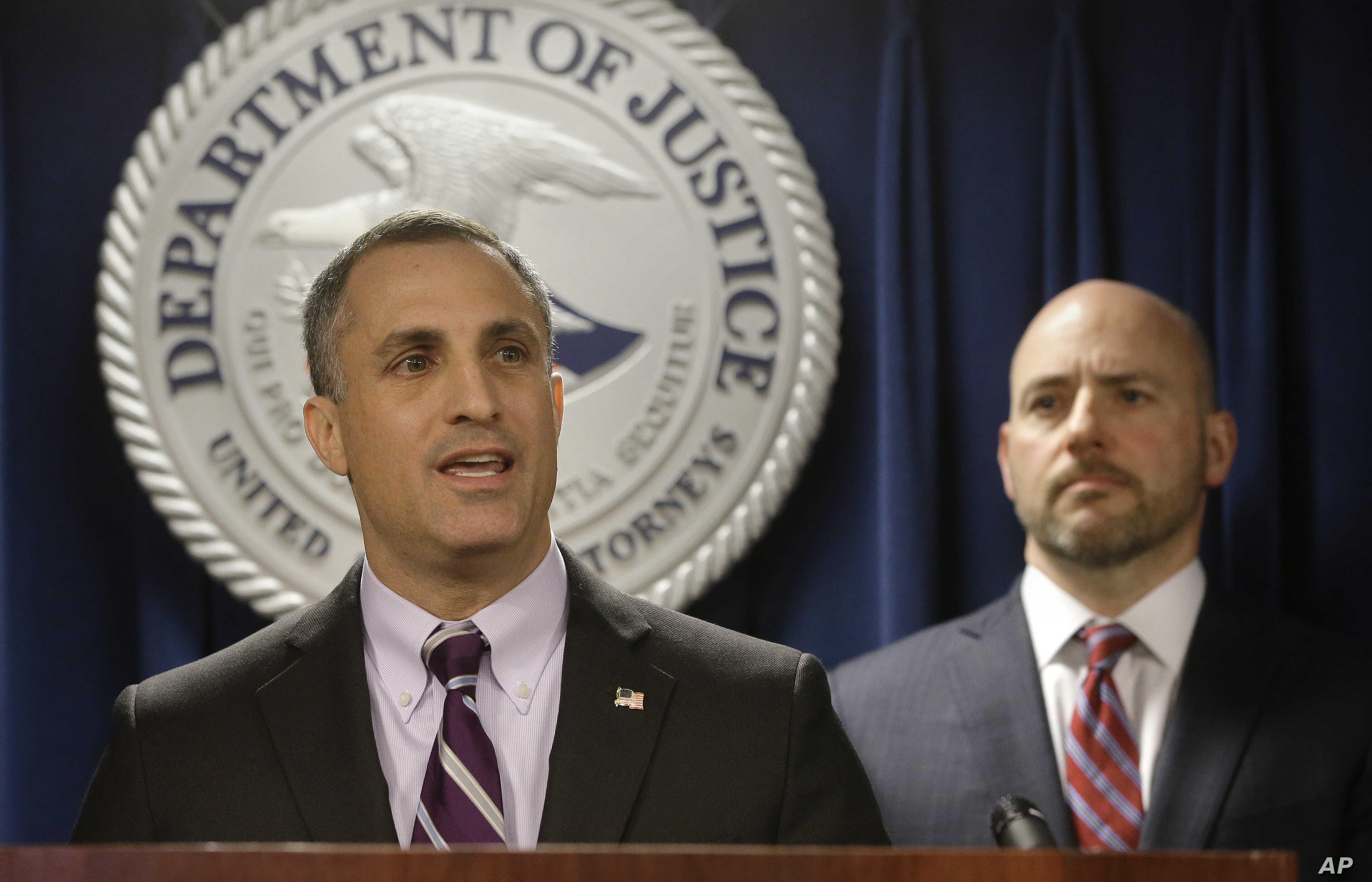 FBI Special Agent in Charge Boston Division Joseph Bonavolonta, left, and U.S. Attorney for District of Massachusetts Andrew Lelling, right, face reporters as they announce indictments in a sweeping college admissions bribery scandal during a news co...