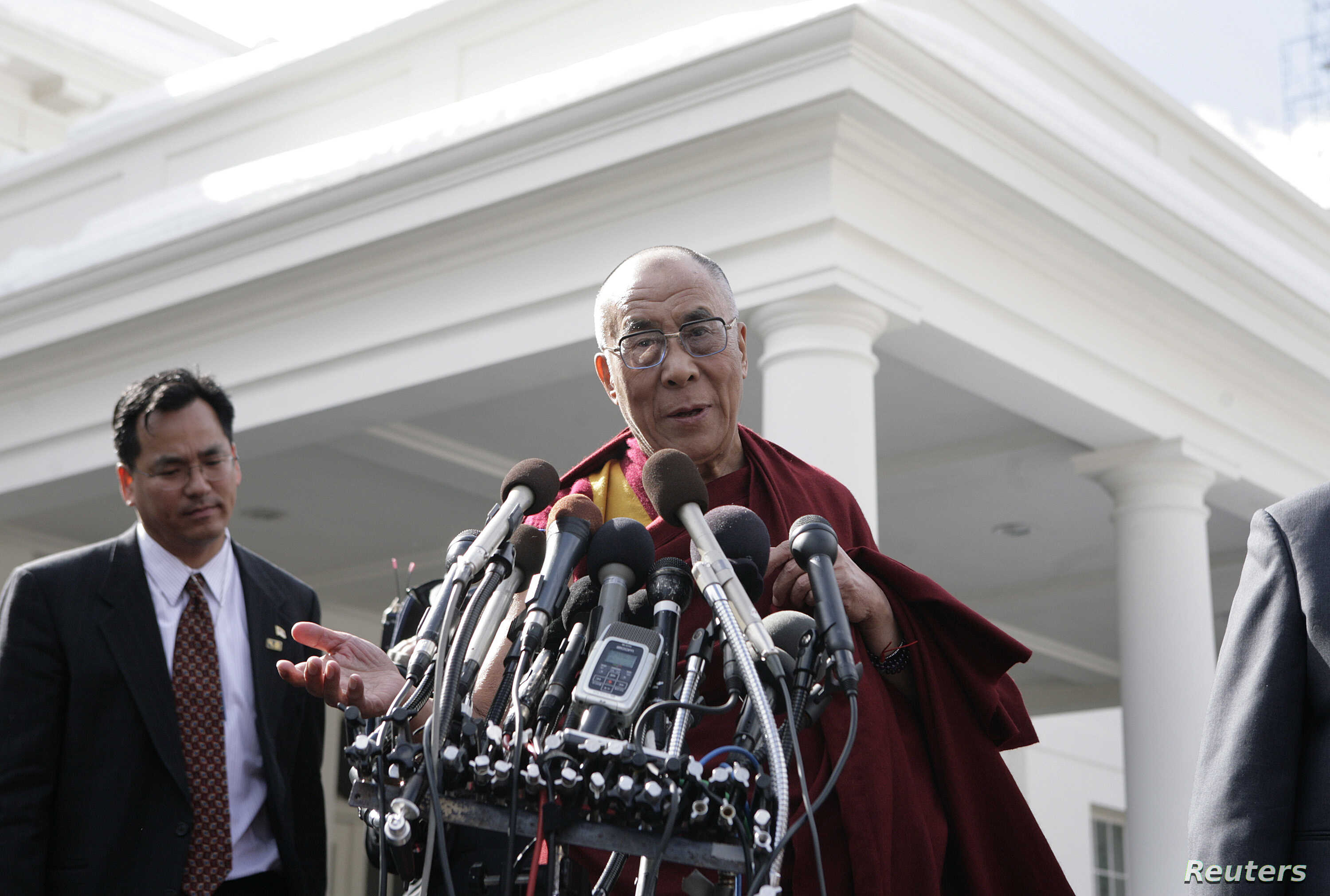 FILE - The Tibetan spiritual leader the Dalai Lama talks to the media after his meeting with U.S. President Barack Obama at the White House in Washington, Feb. 18, 2010.