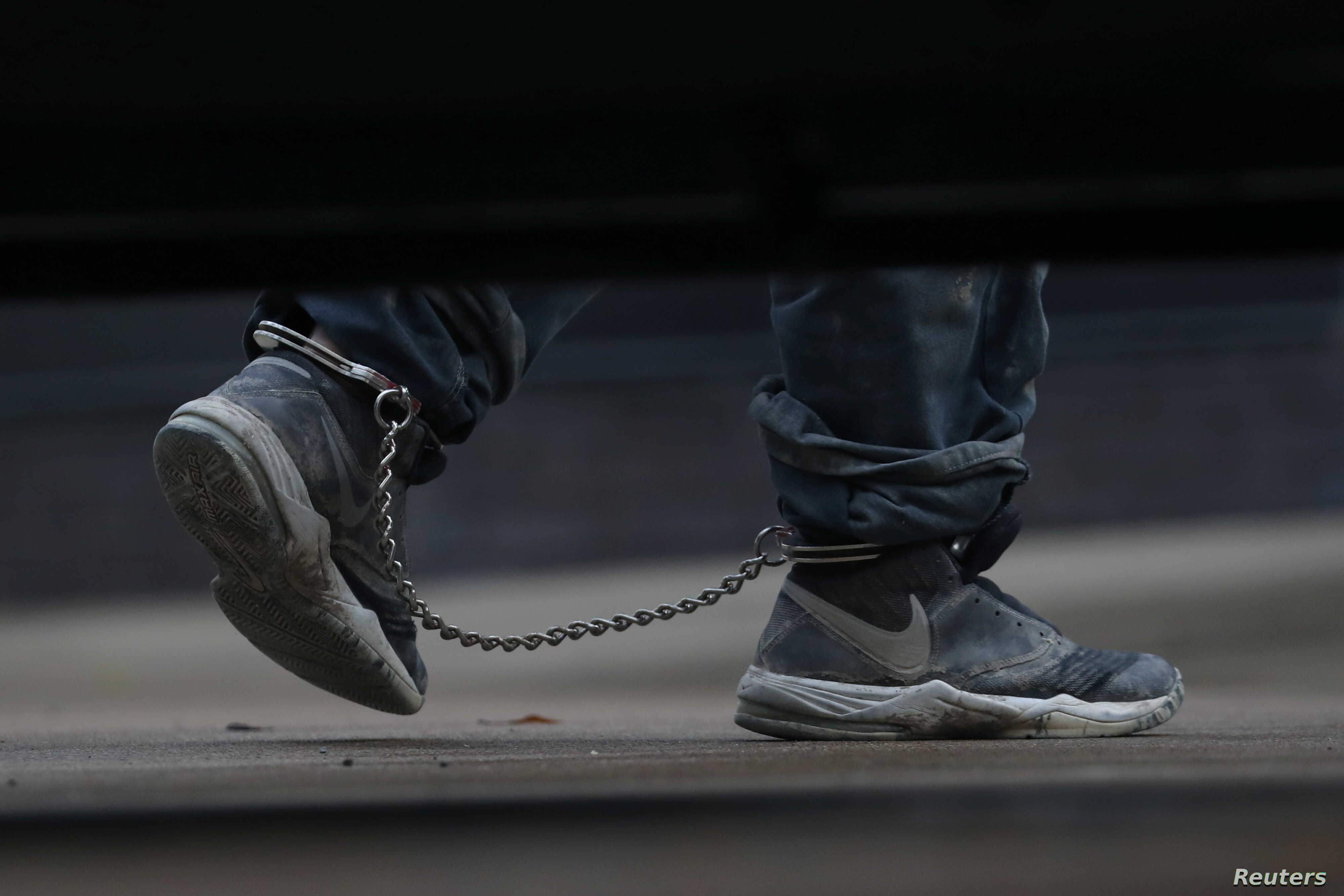 Undocumented immigrants in shackles arrive at a U.S. federal court for hearings in McAllen, Texas, U.S., June 22, 2018.