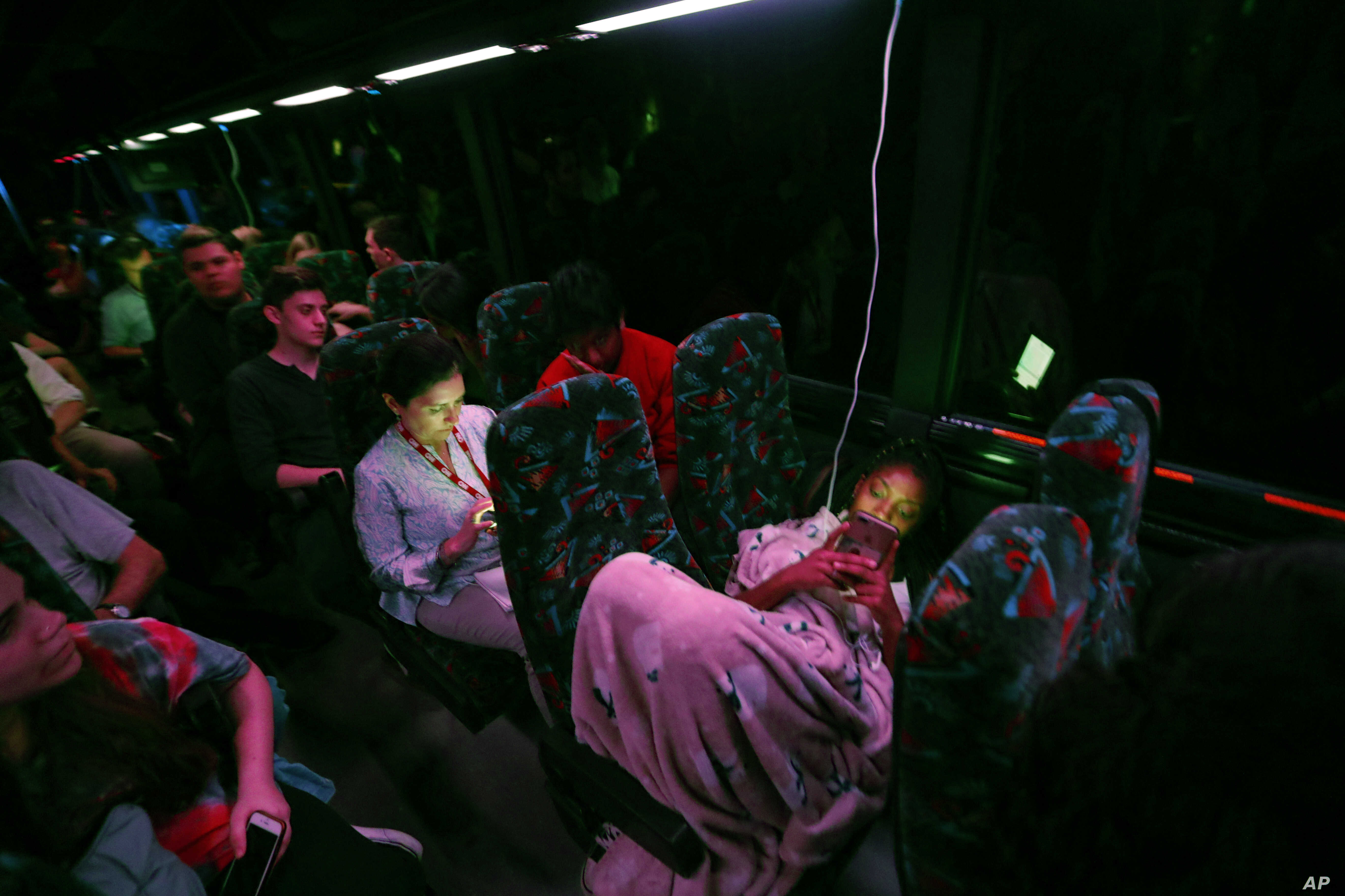Student survivors from Marjory Stoneman Douglas High School, where 17 students and faculty were killed in a shooting last Wednesday, ride during the night aboard their bus between Parkland, Fla., and Tallahassee, Fla., Feb. 20, 2018, to rally outside...