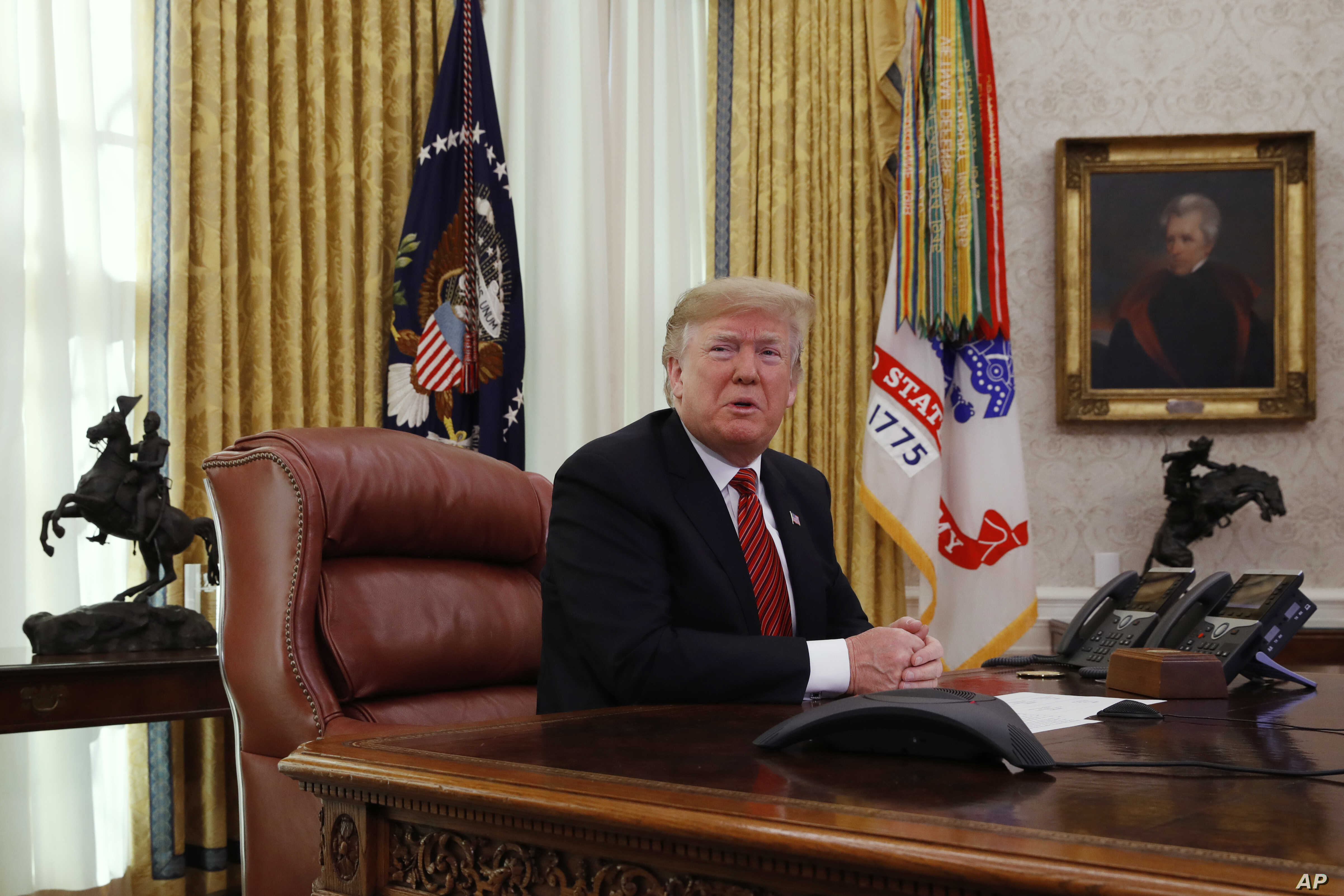 President Donald Trump answers questions from the media after speaking with members of the military by video conference on Christmas Day, Dec. 25, 2018, in the Oval Office of the White House.