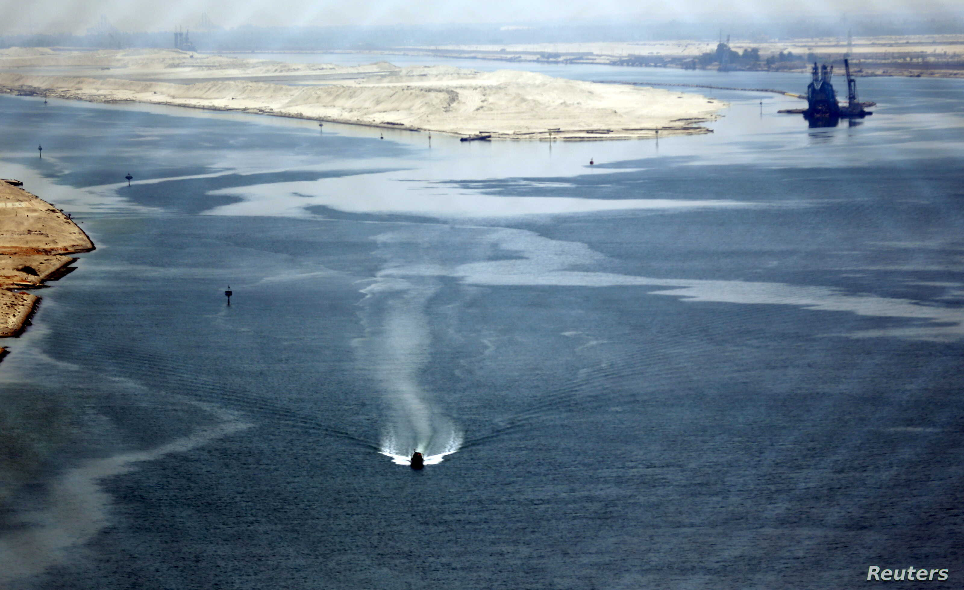 """A general view of the Suez Canal is seen from Al Salam """"Peace"""" bridge on the Ismalia desert road before the opening ceremony of the New Suez Canal, in Egypt, Aug. 6, 2015."""