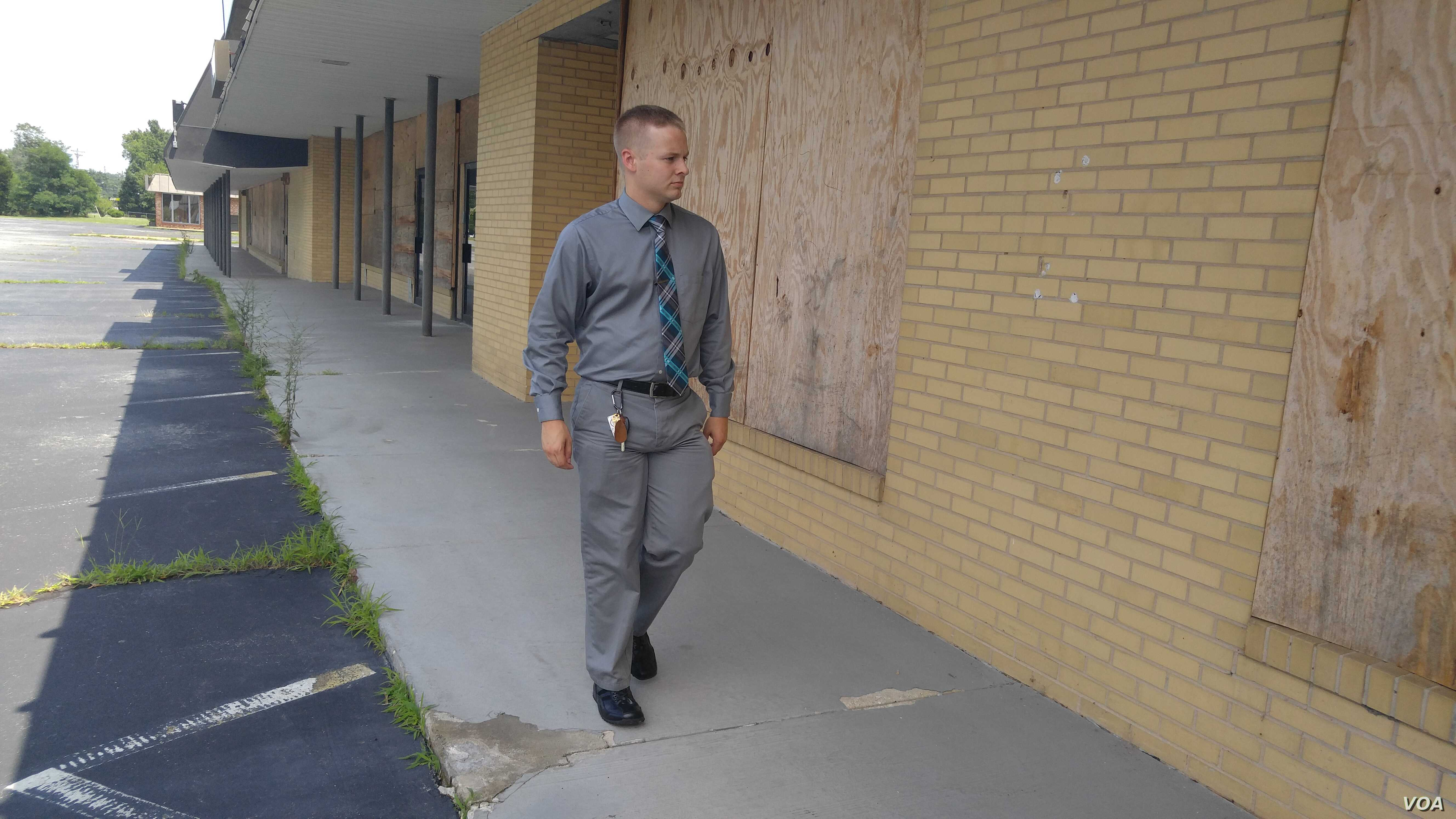 Paulin's top priority is to restore business in some boarded up buildings along the highway.