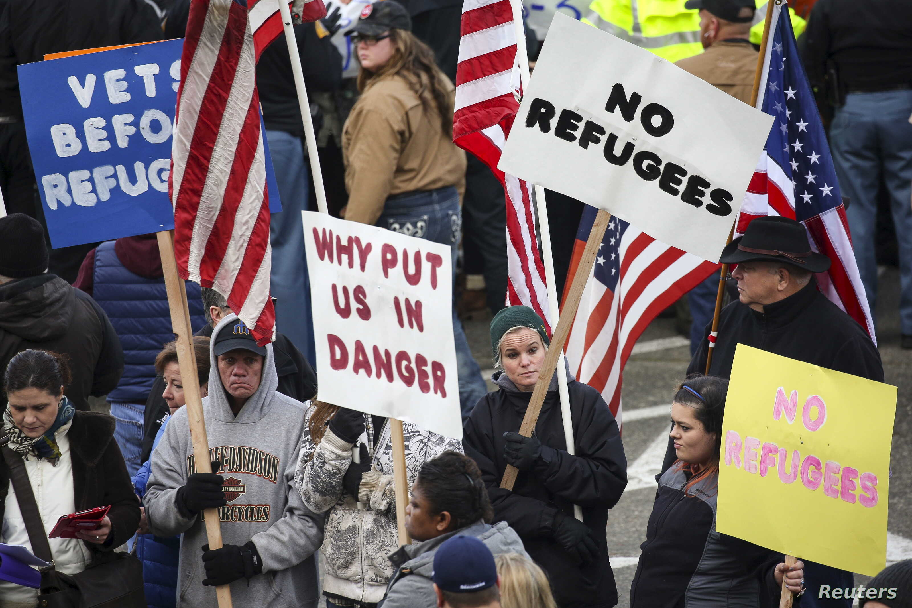 People gather to protest against the United States' acceptance of Syrian refugees at the Washington State capitol in Olympia, Washington, Nov. 20, 2015.