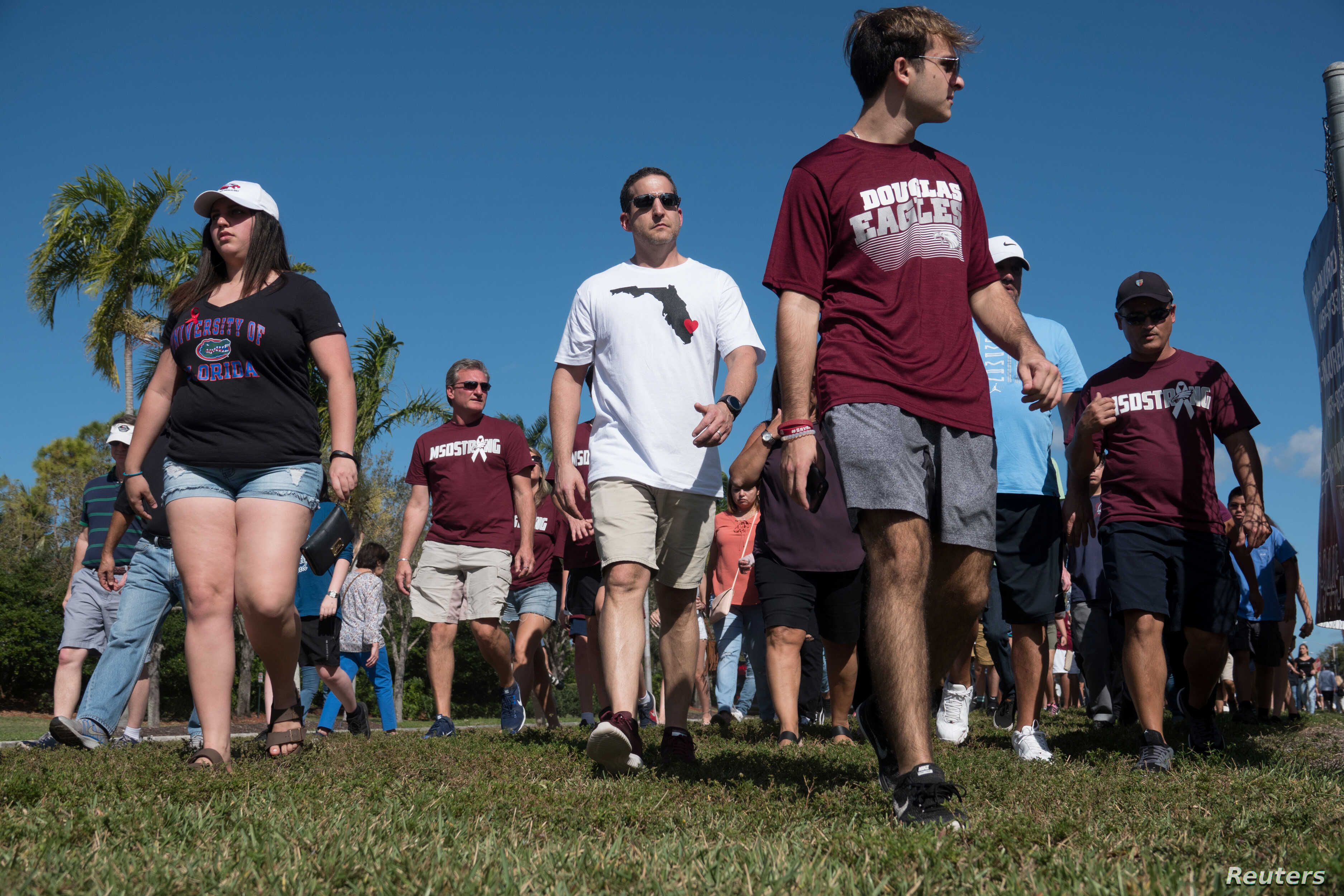 Students and parents arrive for voluntary campus orientation at the Marjory Stoneman Douglas High School, Feb. 25, 2018. The school reopens Wednesday, following the Valentine's Day mass shooting in Parkland, Florida.