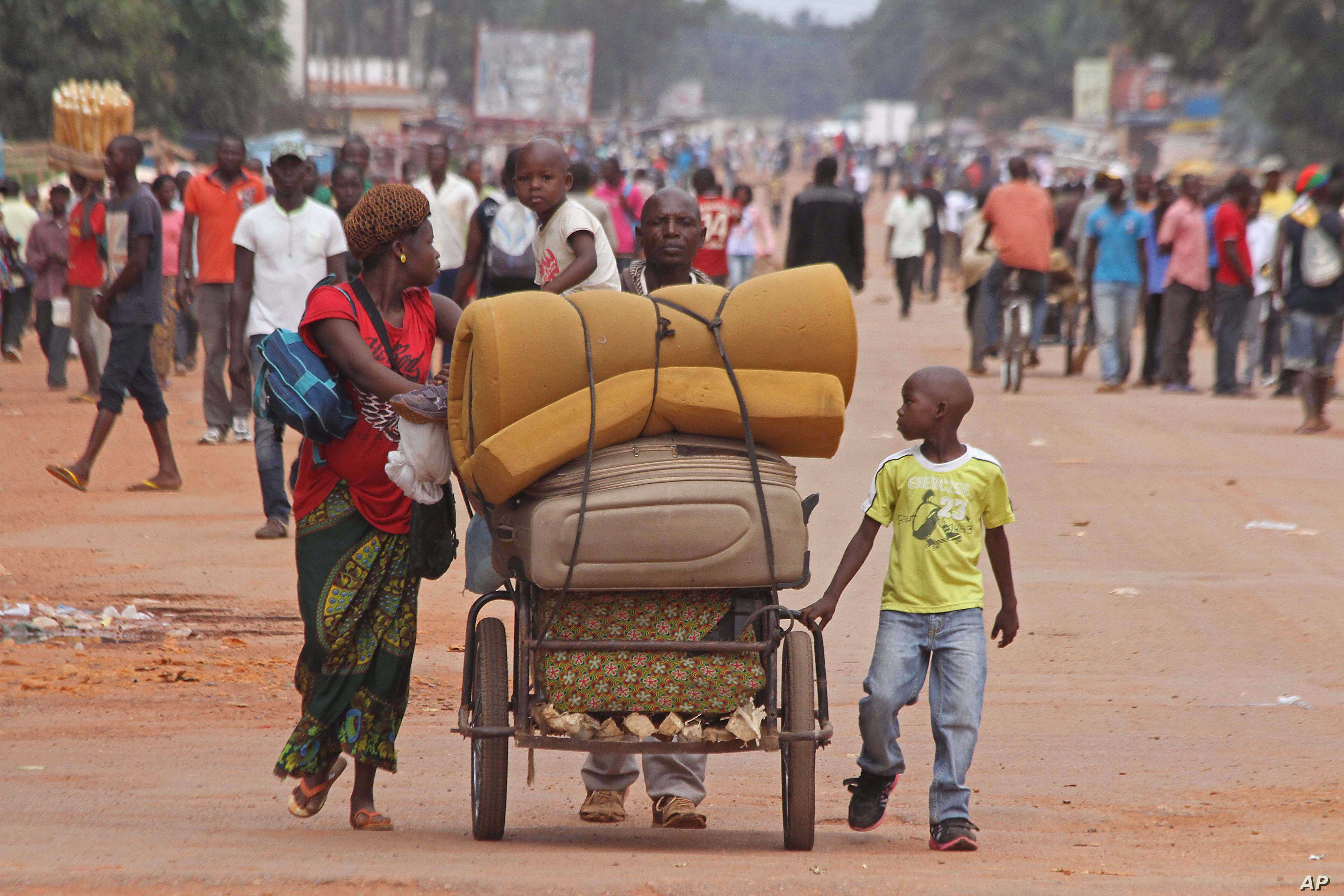 A family with there belongings on a makeshift trolley in the city of Bangui, Central African Republic, as clashes sectarian clashes erupted between rivaling Christian and Muslim militias, Sept. 30, 2015.