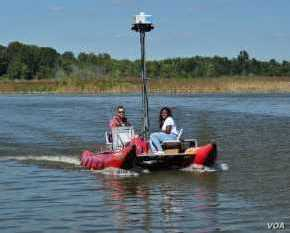 Ryan Abrahamsen, founder of Terrain 360, a virtual river mapping company, on the Patuxent River in Maryland, with passenger.