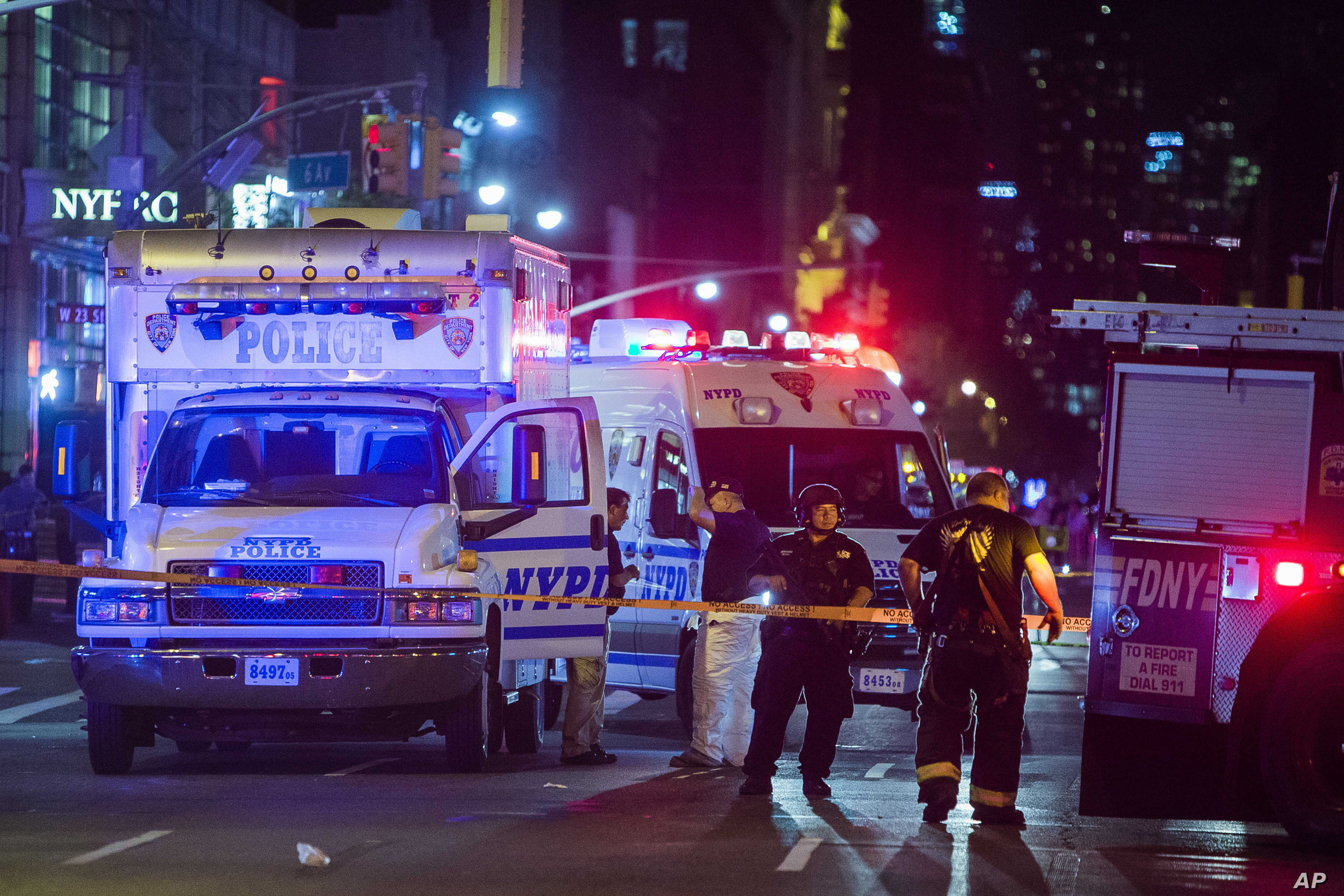 Police and firefighters work near to the scene in Manhattan, New York, Sept. 17, 2016.