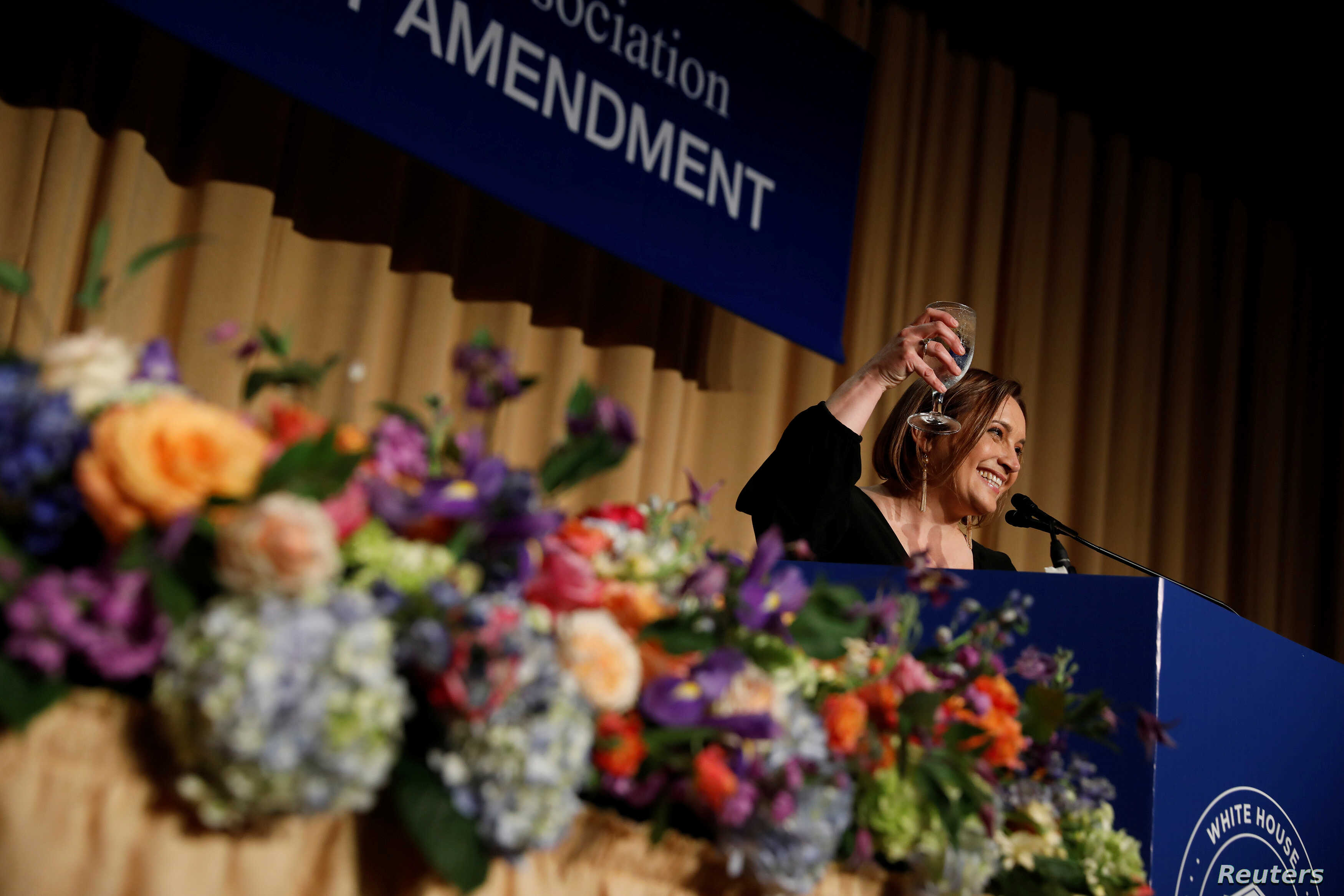 White House Correspondents' Association President Margret Margaret Talev speaks at the White House Correspondents' Association dinner in Washington, U.S., April 28, 2018.