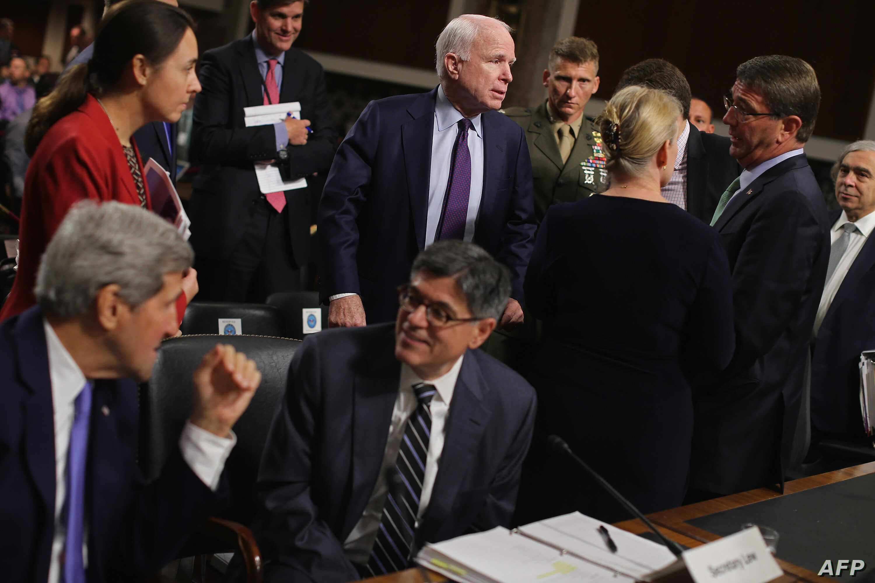 Senate Armed Services Committee Chairman John McCain, center, talks with, from left, Secretary of State John Kerry, Treasury Secretary Jacob Lew, Senator Kirsten Gillibrand, Defense Secretary Ashton Carter and Energy Secretary Ernest Moniz on Capitol...