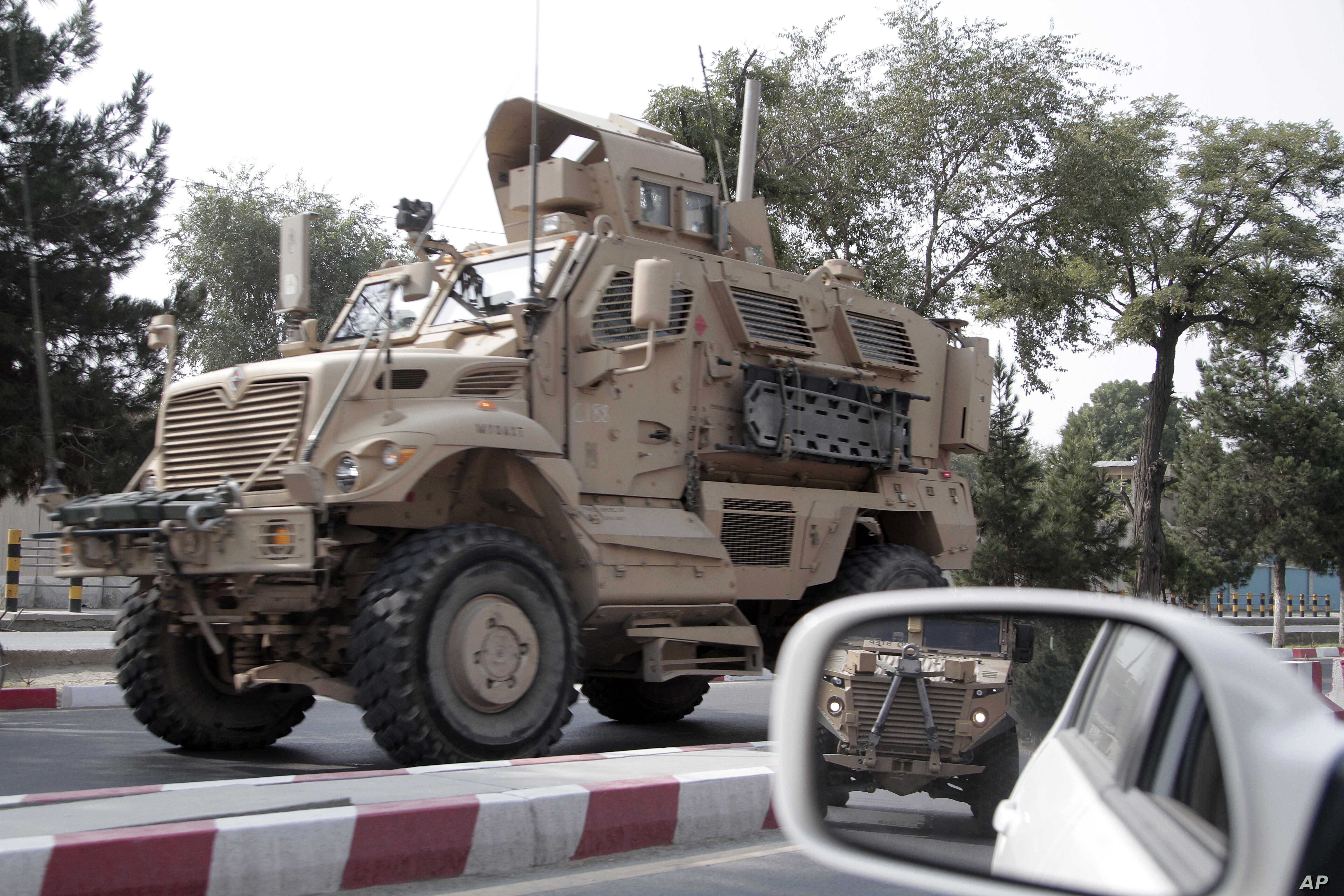 "A U.S. armored vehicle patrols in Kabul, Afghanistan, Aug. 23, 2017. In a national address Monday, U.S. President Donald Trump reversed his past calls for a speedy exit and recommitted the U.S. to the 16-year-old conflict, saying U.S. troops must ""fi..."