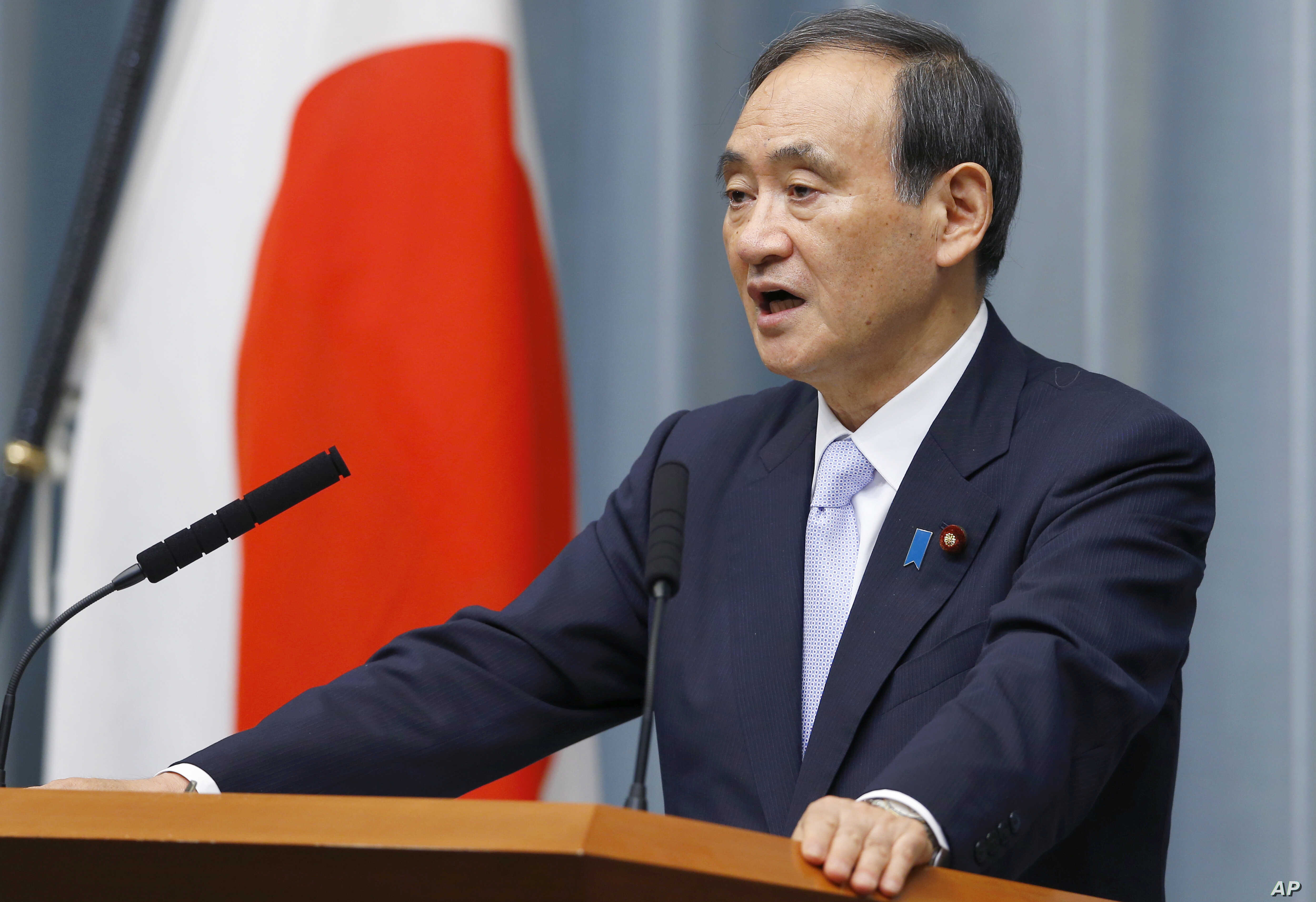 Japan's Chief Cabinet Secretary Yoshihide Suga speaks during a press conference to announce cabinet changes at the prime minister's official residence in Tokyo, Aug. 3, 2017.
