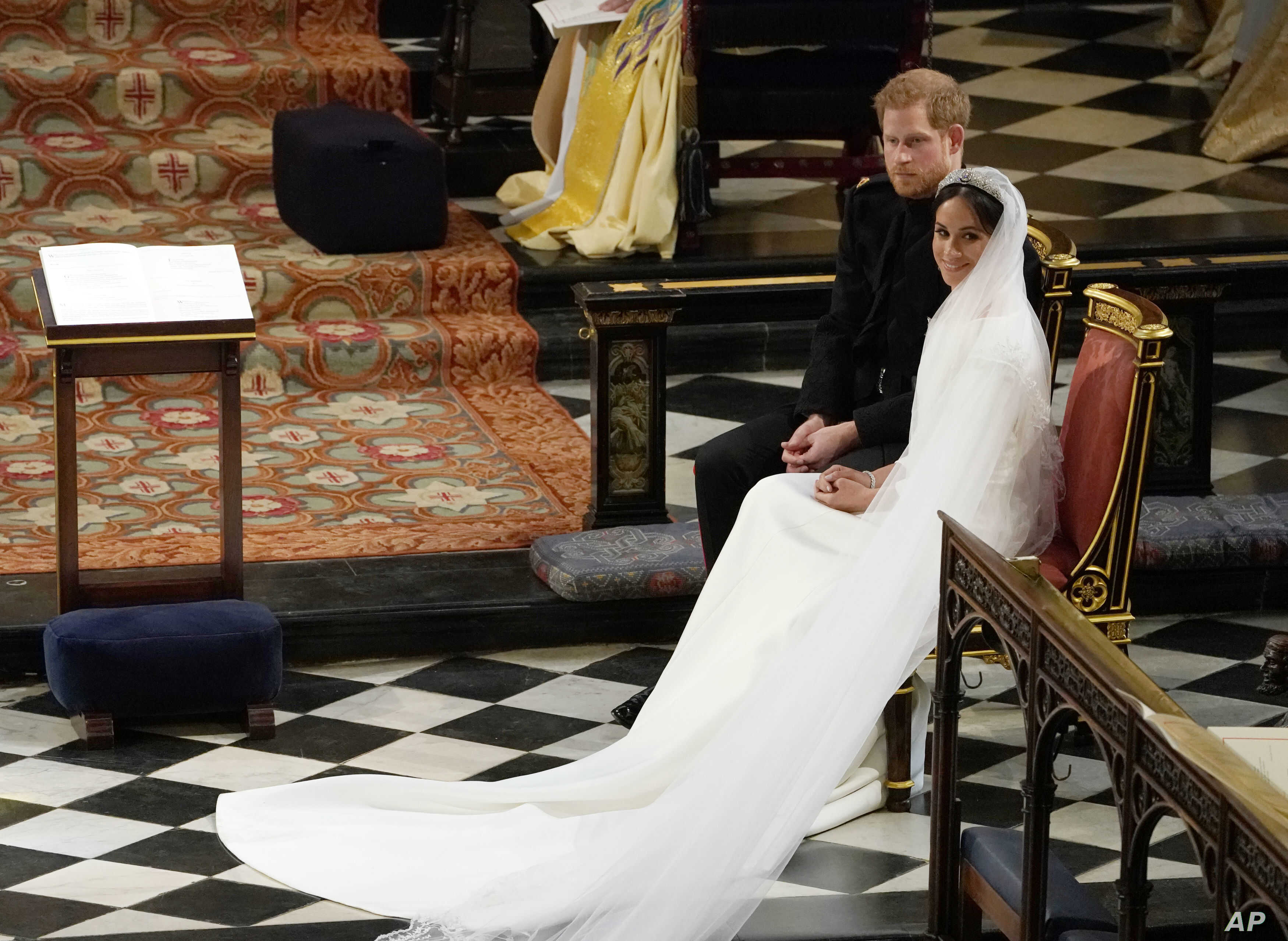 Britain's Prince Harry and Meghan Markle during their wedding at St. George's Chapel in Windsor Castle in Windsor, near London, England, Saturday, May 19, 2018.