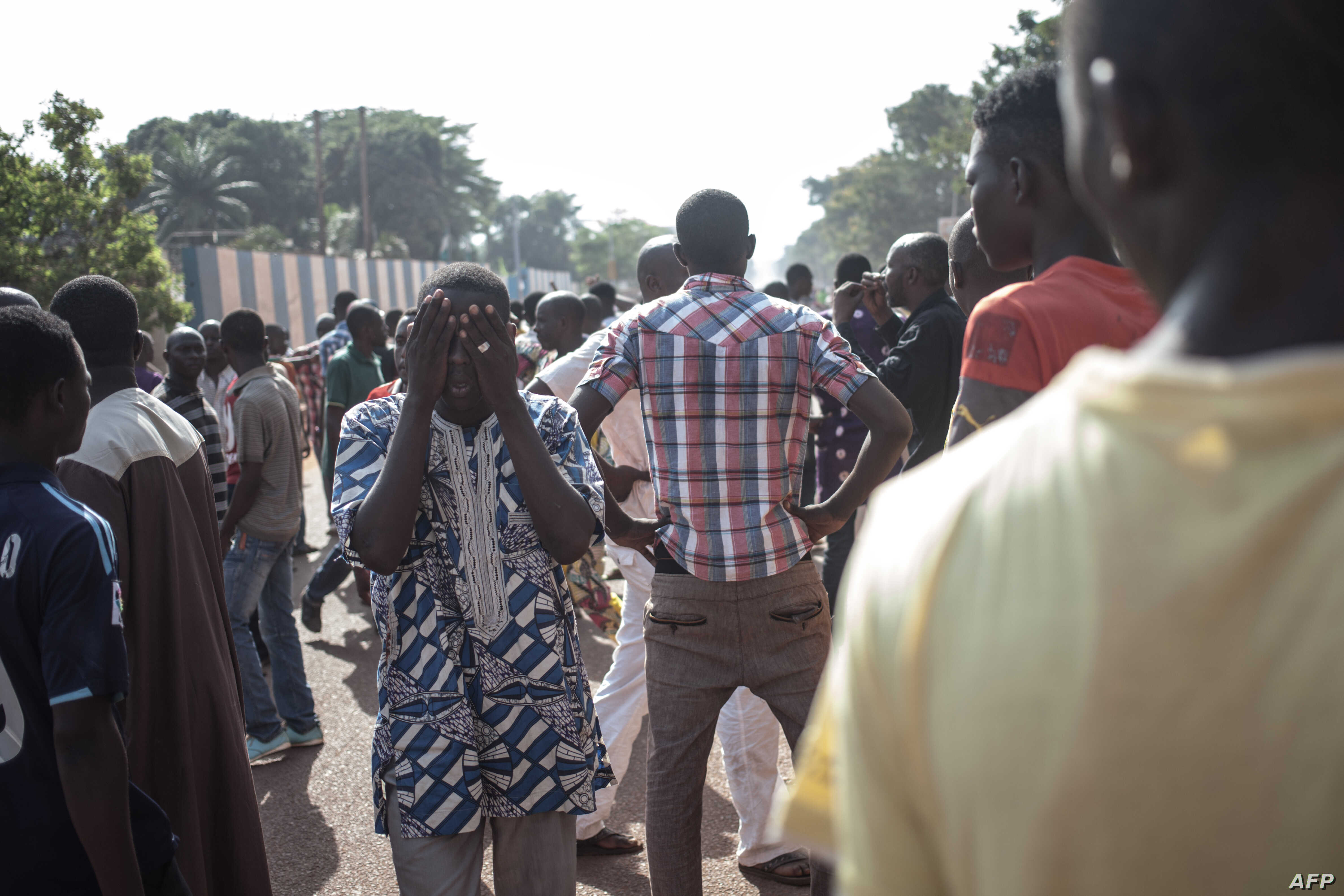 FILE - Residents of the PK5, a Muslim-majority district, demonstrate in front of the headquarters of MINUSCA, the UN peacekeeping mission in Central Africa Republic, following clashes in Bangui, on April 11, 2018.