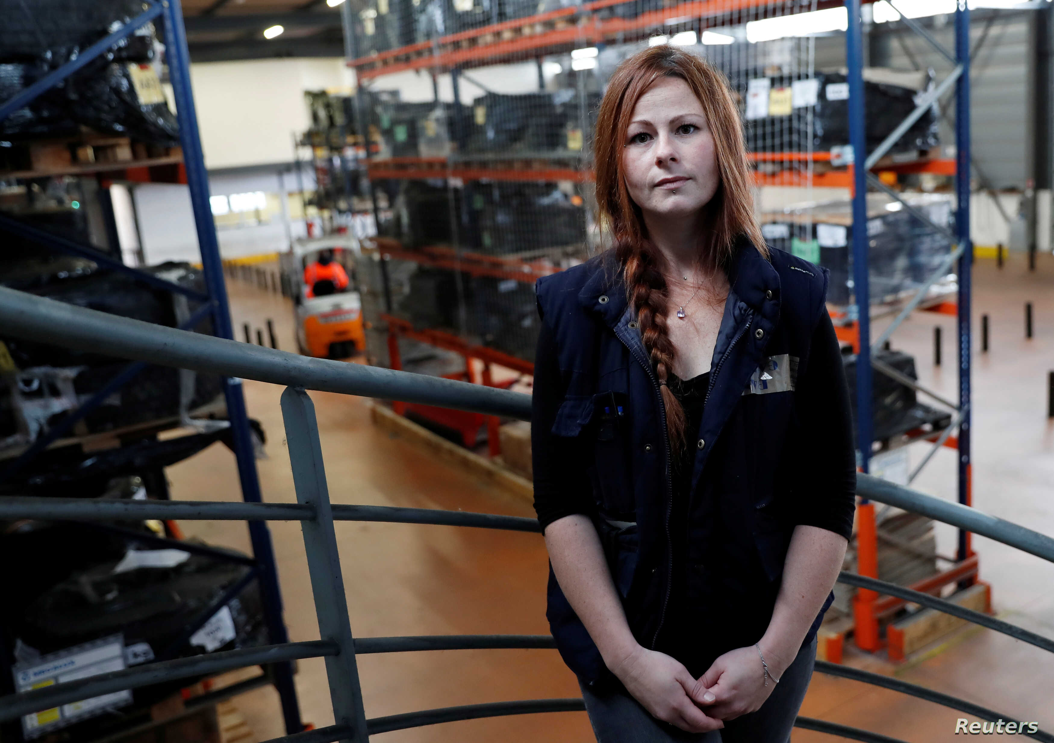 French apprentice Celine Galland, 31 years old, poses in a training area at ''AFTRAL'', a transport and logistics training centre, in Savigny-le-Temple, France, Oct. 26, 2017.