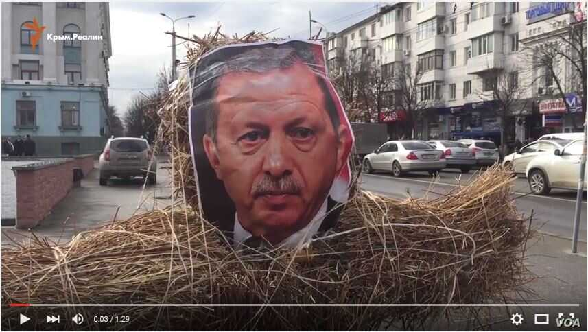 In this screen grab Friday, activists in Simferopol, a city annexed along with the Crimean peninsula, burned an effigy of Turkish President Recept Tayyip Erdogan.