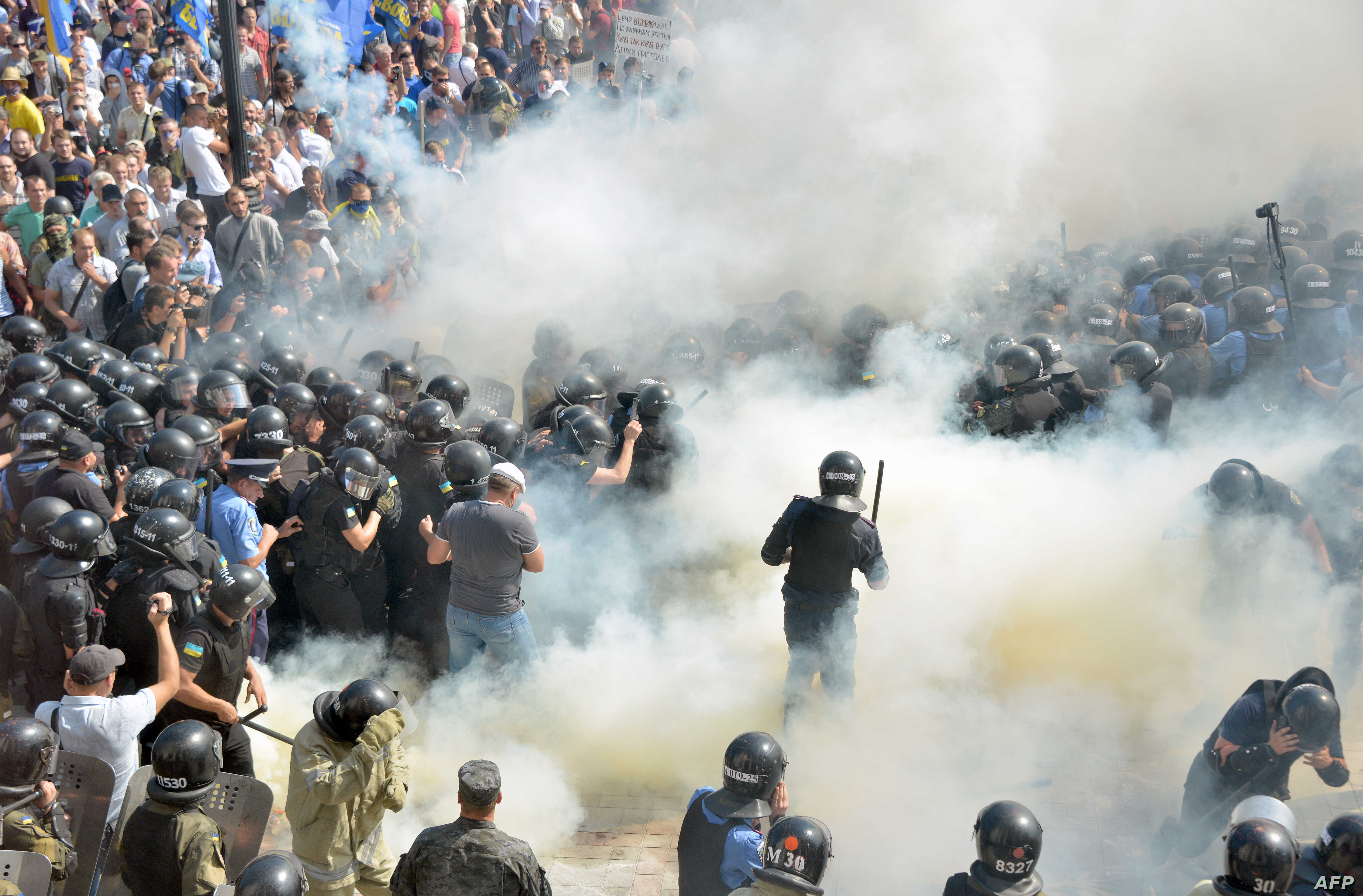 Smoke rises near the parliament building in Kiev as activists of radical Ukrainian parties, including the Ukrainian nationalist party Svoboda (Freedom), clash with police officers on August 31, 2015.