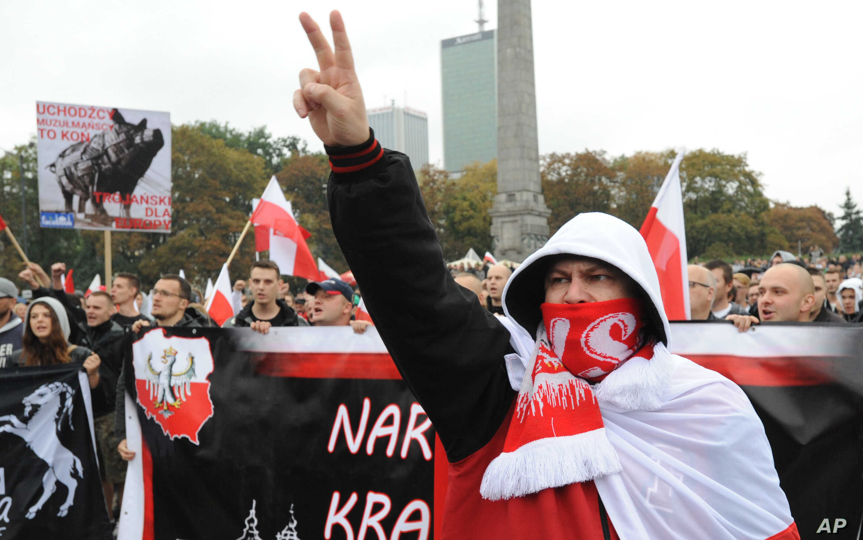 Protesters shout anti-migrant slogans as several thousand right-wing nationalists march through downtown Warsaw, demonstrating against EU-proposed quotas for Poland to spread the human tide of refugees around Europe, Sept. 12, 2015.