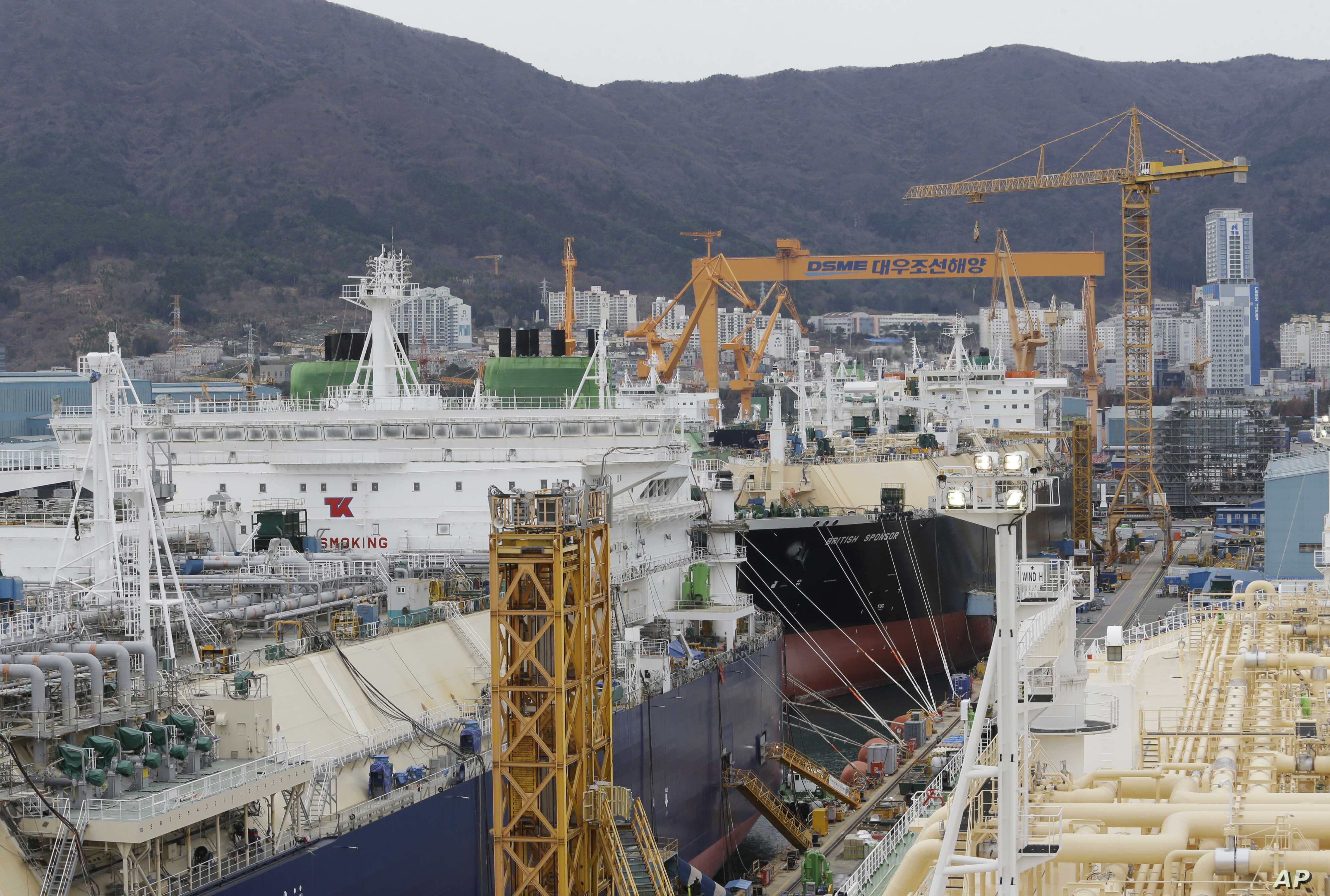 Large liquefied natural gas (LNG) carriers are being constructed at the Daewoo Shipbuilding and Marine Engineering facility in Geoje Island, South Korea, Dec. 7, 2018. South Korea's big three shipbuilders — Daewoo, Hyundai Heavy Industries and Sa...