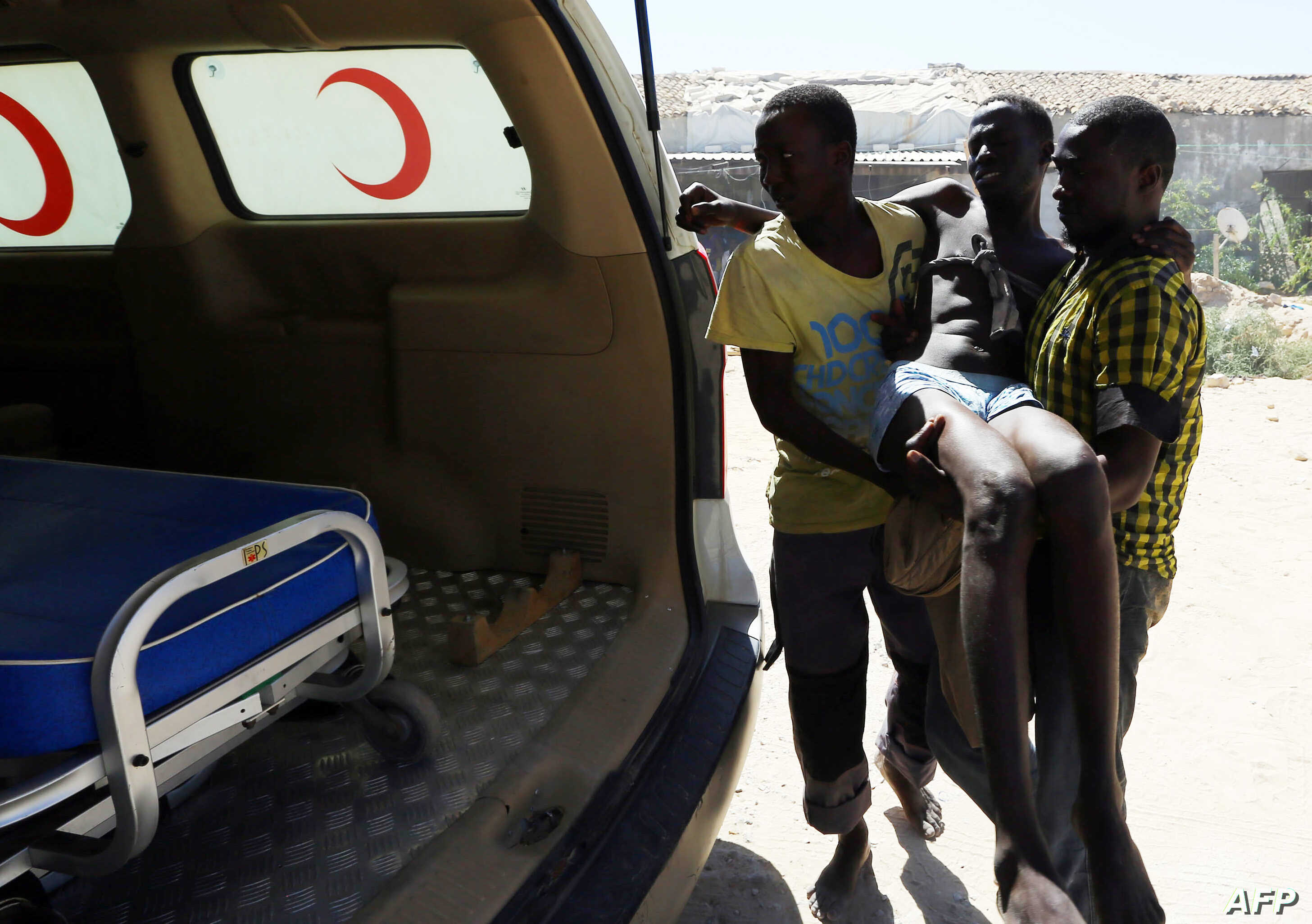 An illegal migrant is carried to an ambulance after he was rescued by the Libyan coast guard when the boat he was on sank off the coastal town of Garabulli, 60 kilometers east of Tripoli, Sept. 15, 2014.