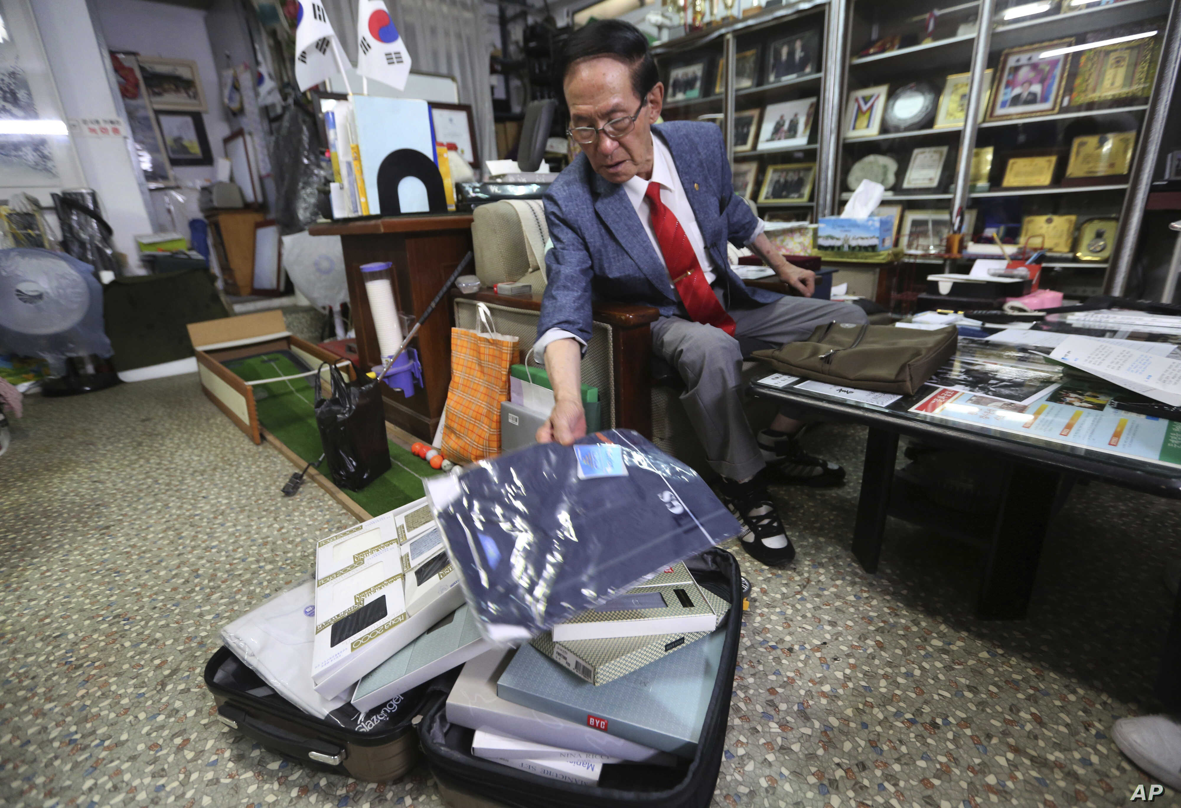Yoon Heung-kyu, 91, shows some gifts for his family members in North Korea during an interview at his office in Seoul, South Korea, Aug. 16, 2018. Yoon will travel to North Korea Monday with other South Koreans to see family members they haven't s...