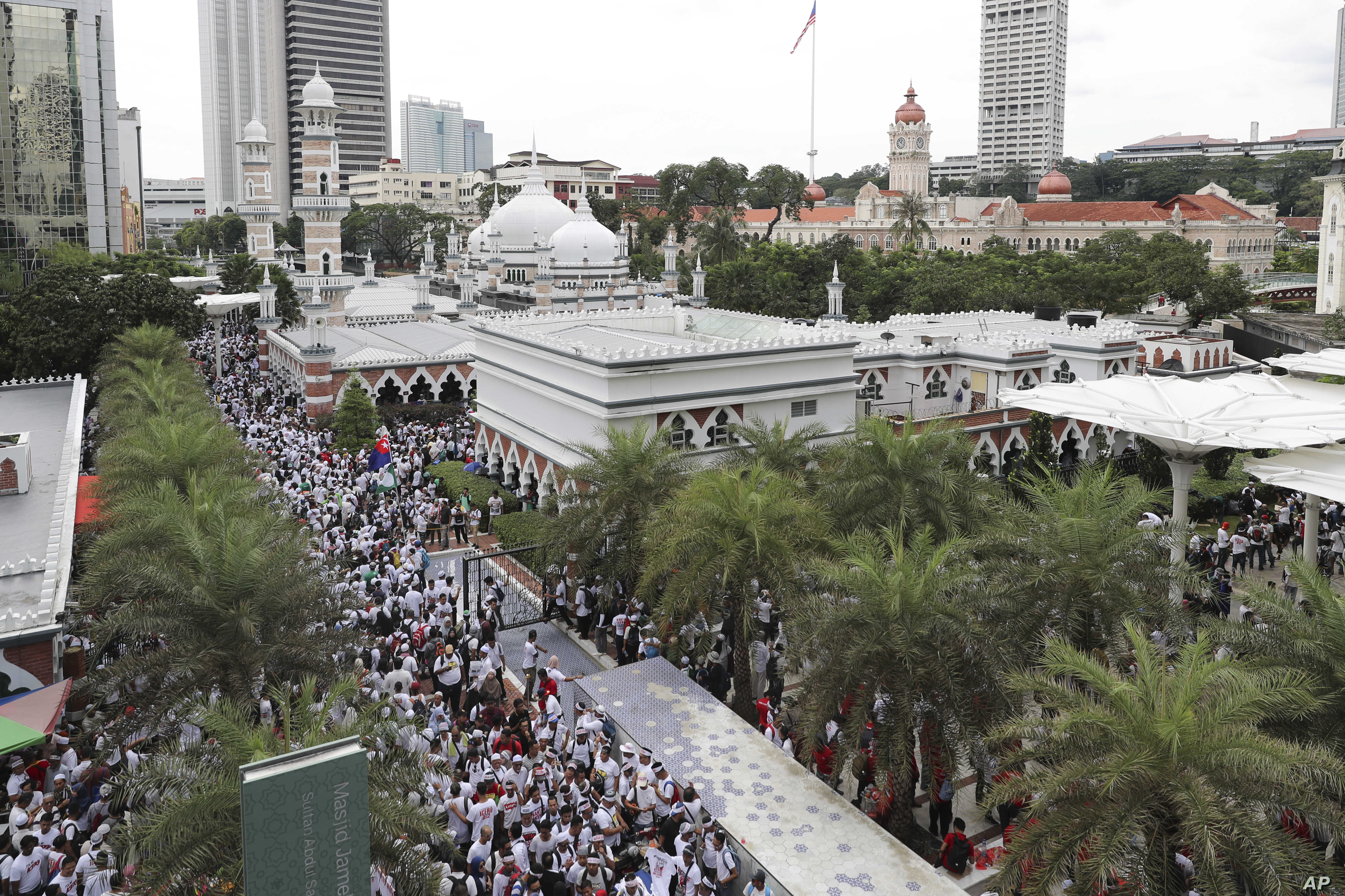 Protesters gather for a rally near a mosque to celebrate the government's decision not to ratify a U.N. anti-discrimination convention, in Kuala Lumpur, Malaysia, Dec. 8, 2018. Thousands of Malaysian Muslims are rallying in Kuala Lumpur against any a...
