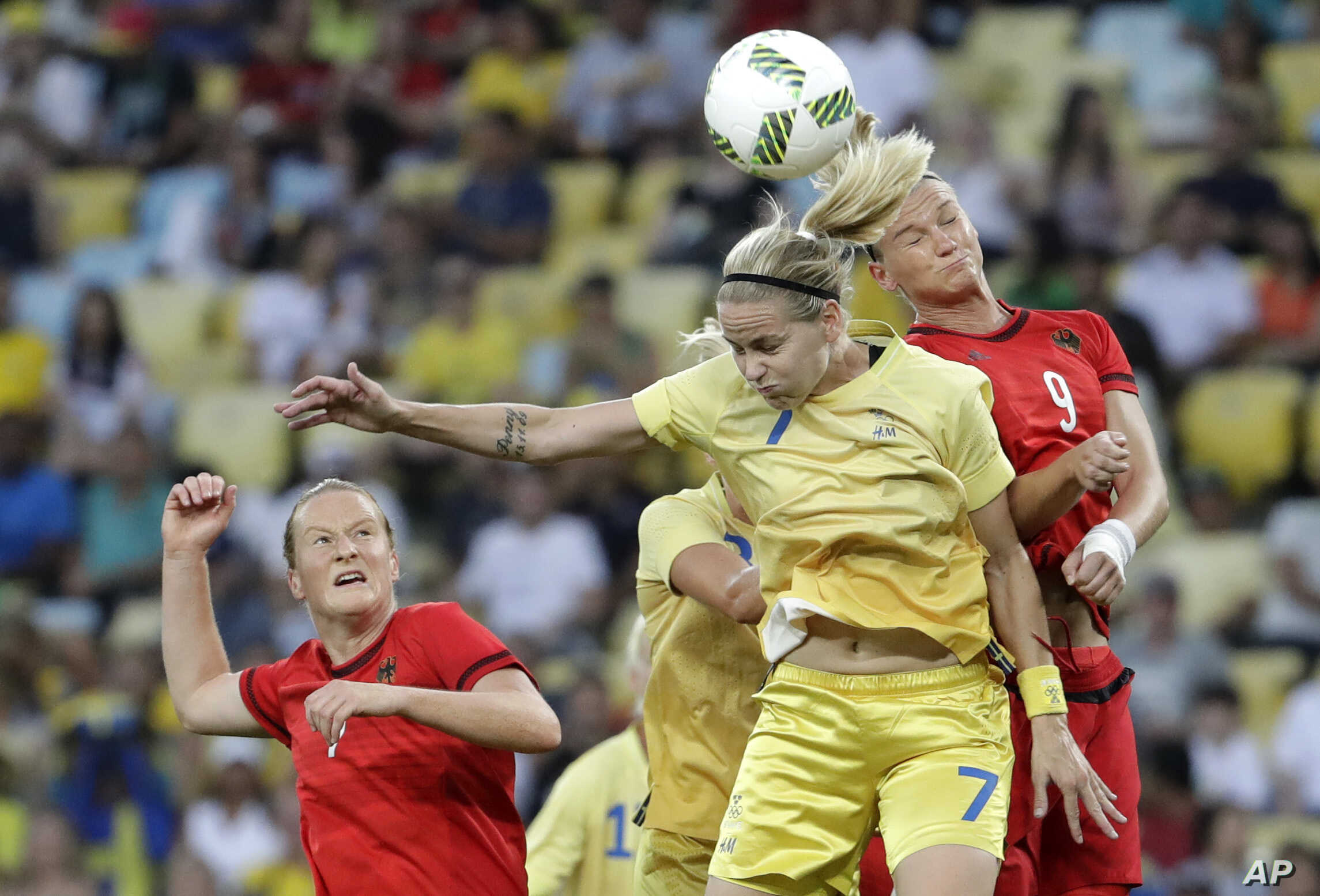 Germany's Alexandra Popp, right, and Sweden's Lisa Dahlkvist go for a header during the final of the women's Olympic tournament won by Germany, Aug. 19, 2016.