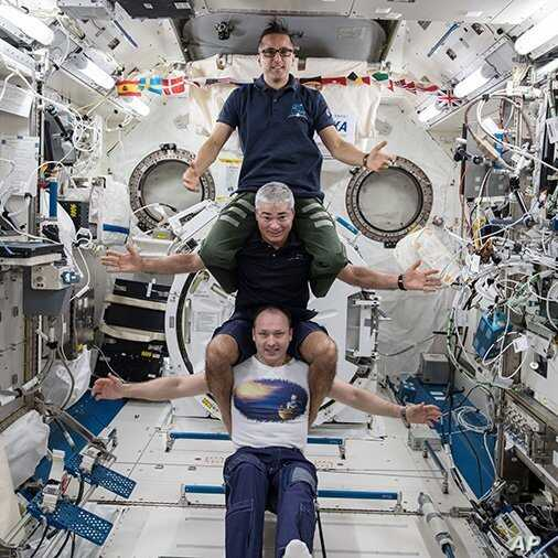 Russia's Alexander Misurkin, bottom, NASA's Mark Vande Hei, middle, and NASA's Joe Acaba at the International Space Station,  Feb. 25, 2018. The three astronauts flew back to Earth Tuesday, following a nearly six-month mission at the Internatio...