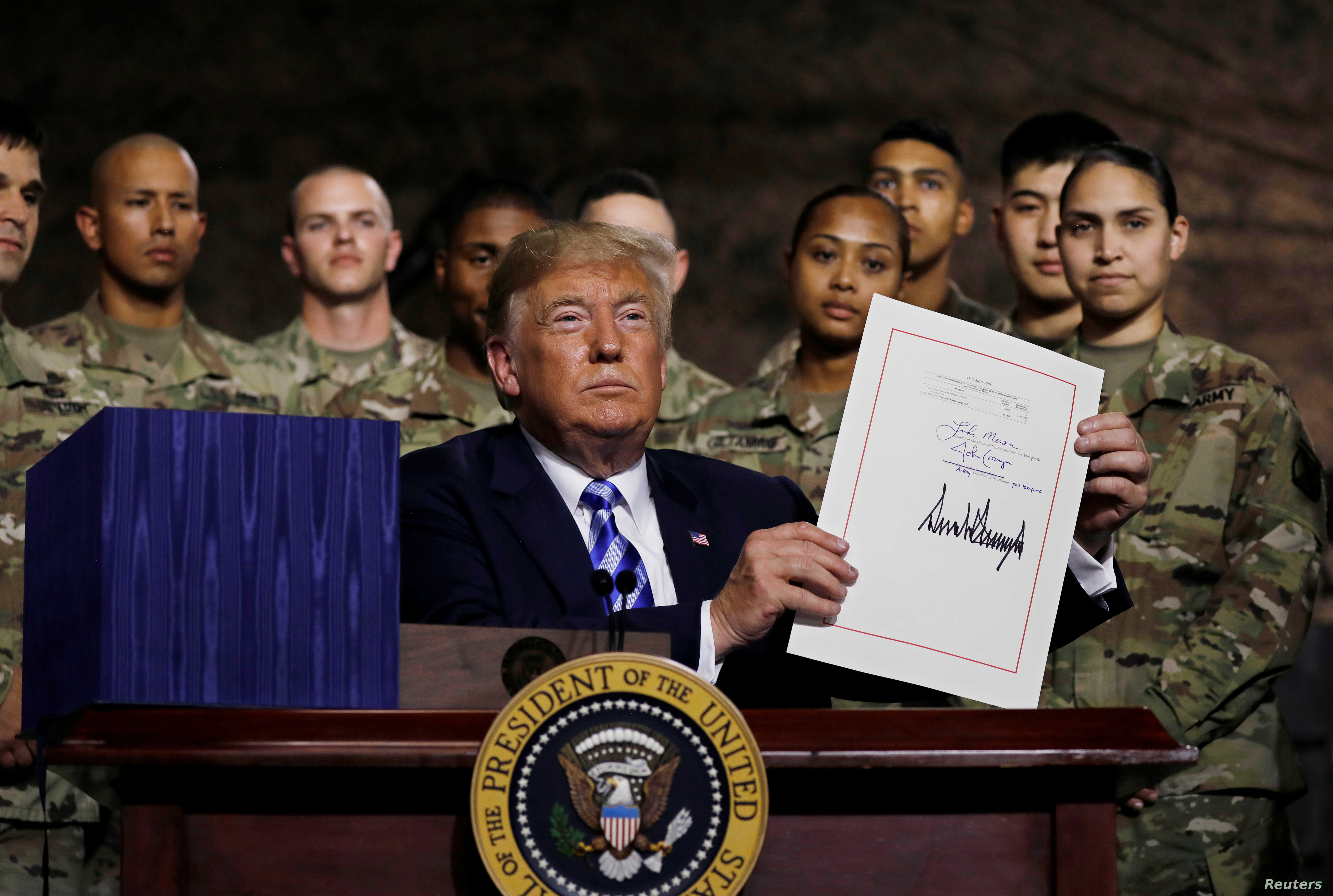 Trump Signs Defense Policy Bill with Watered-down China