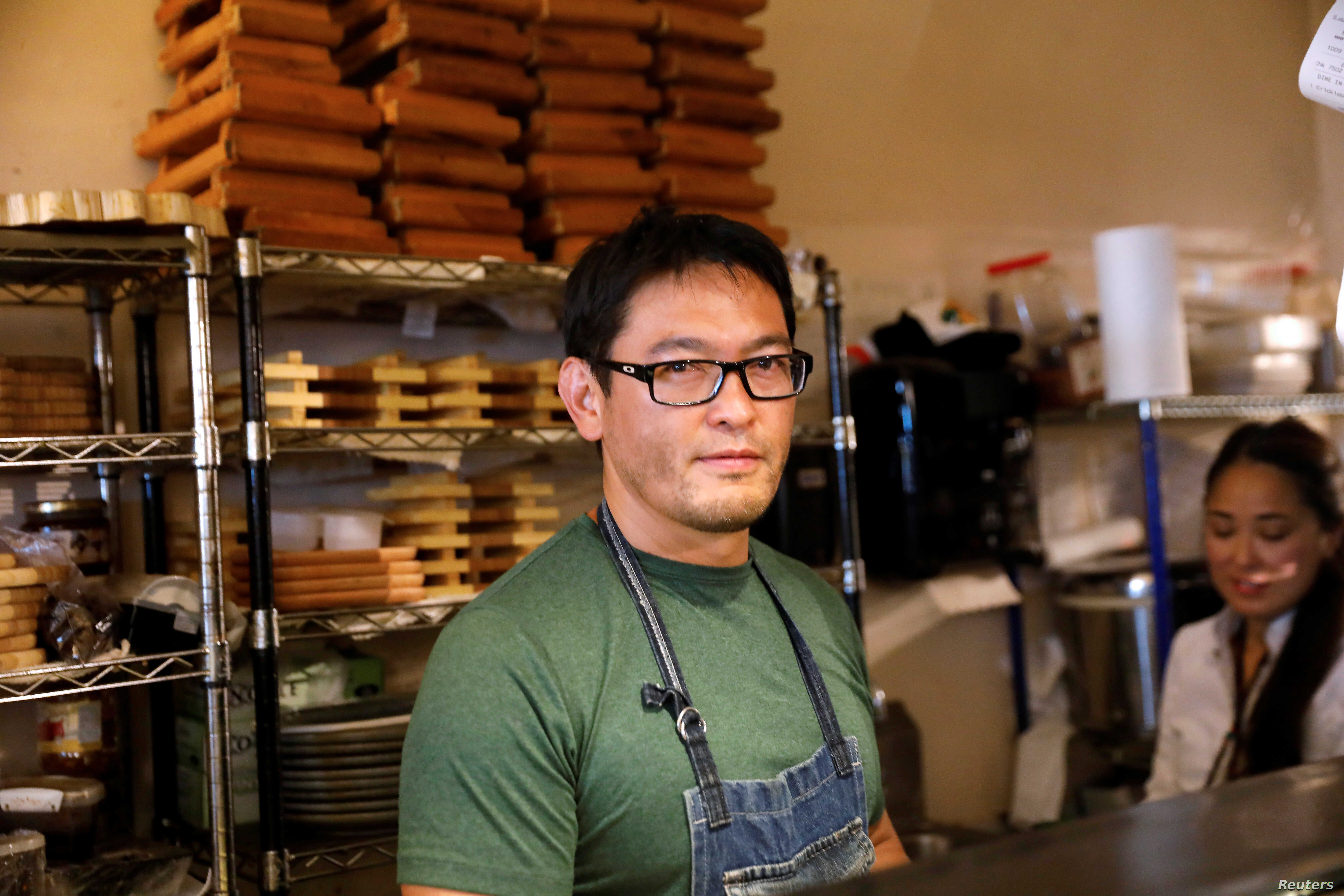 Chef Bun Lai of Miya's Sushi poses at his restaurant in New Haven, Connecticut,  Aug. 28, 2018.